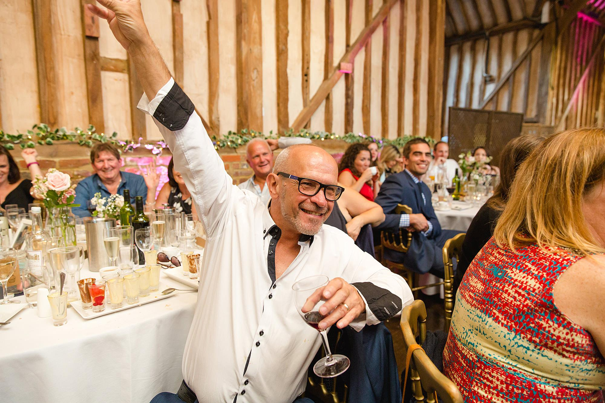 Lillibrooke Manor wedding guest cheering during speeches