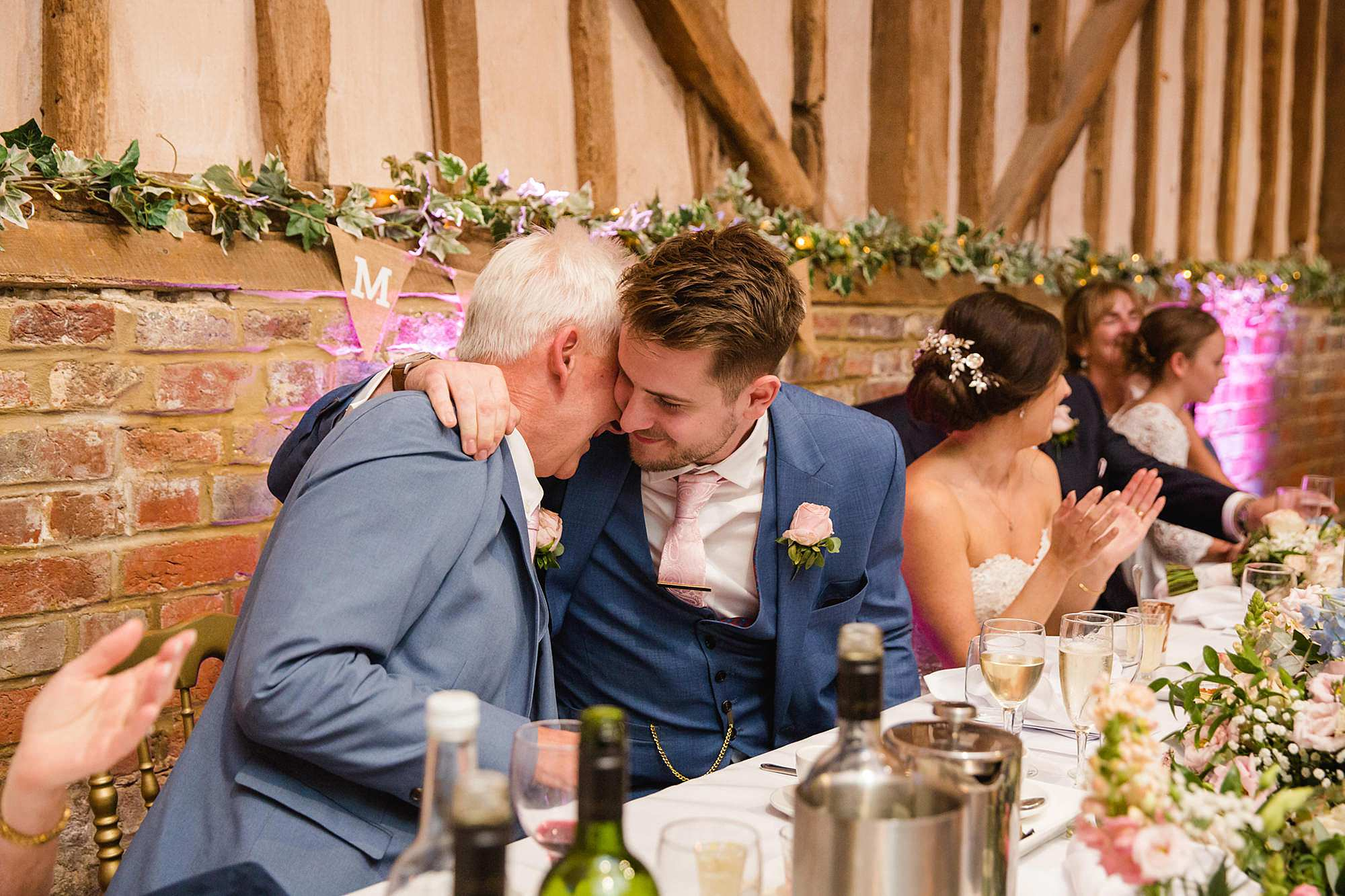 Lillibrooke Manor wedding groom hugs his dad