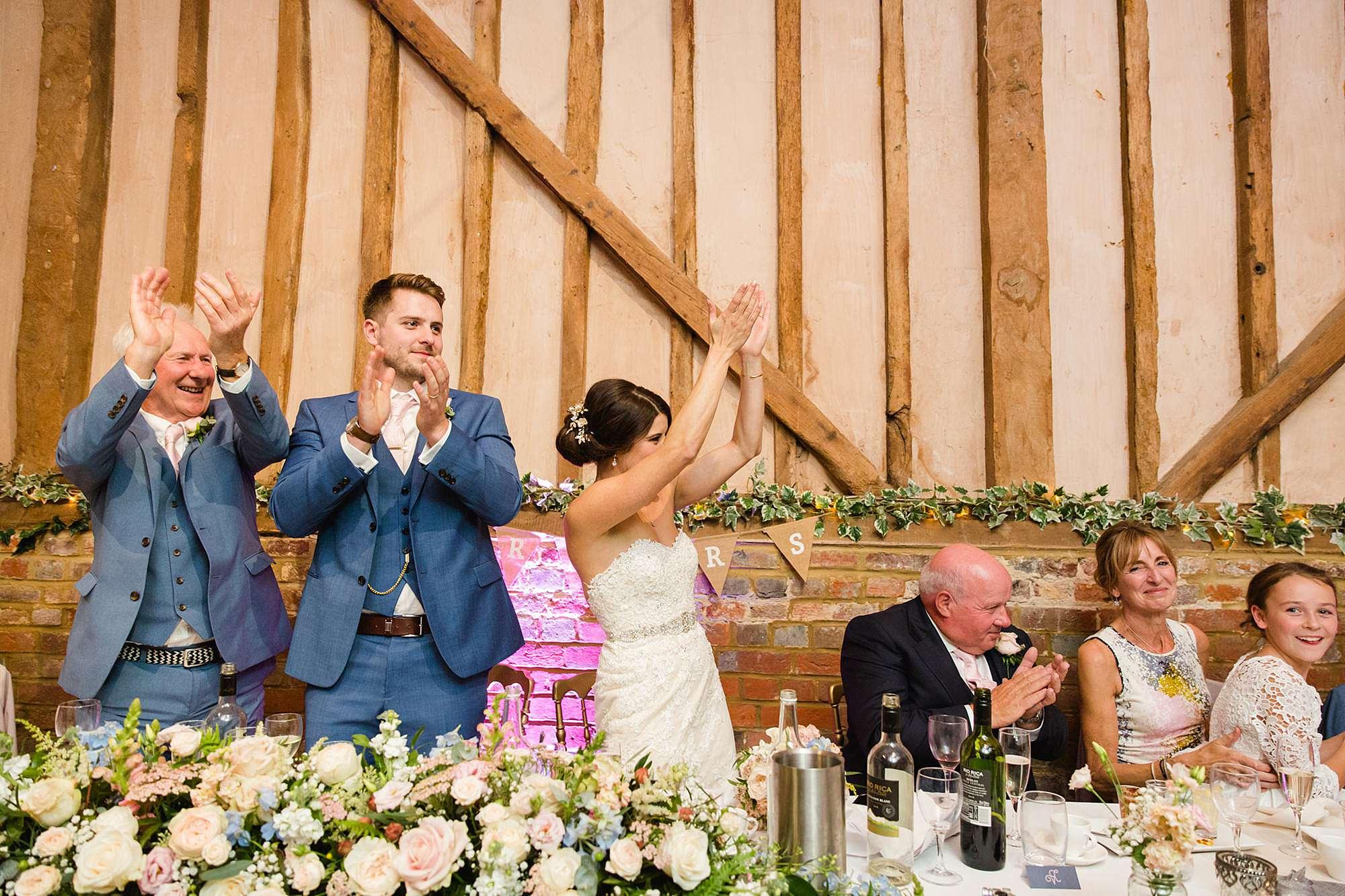 Lillibrooke Manor wedding bride and groom cheer best man