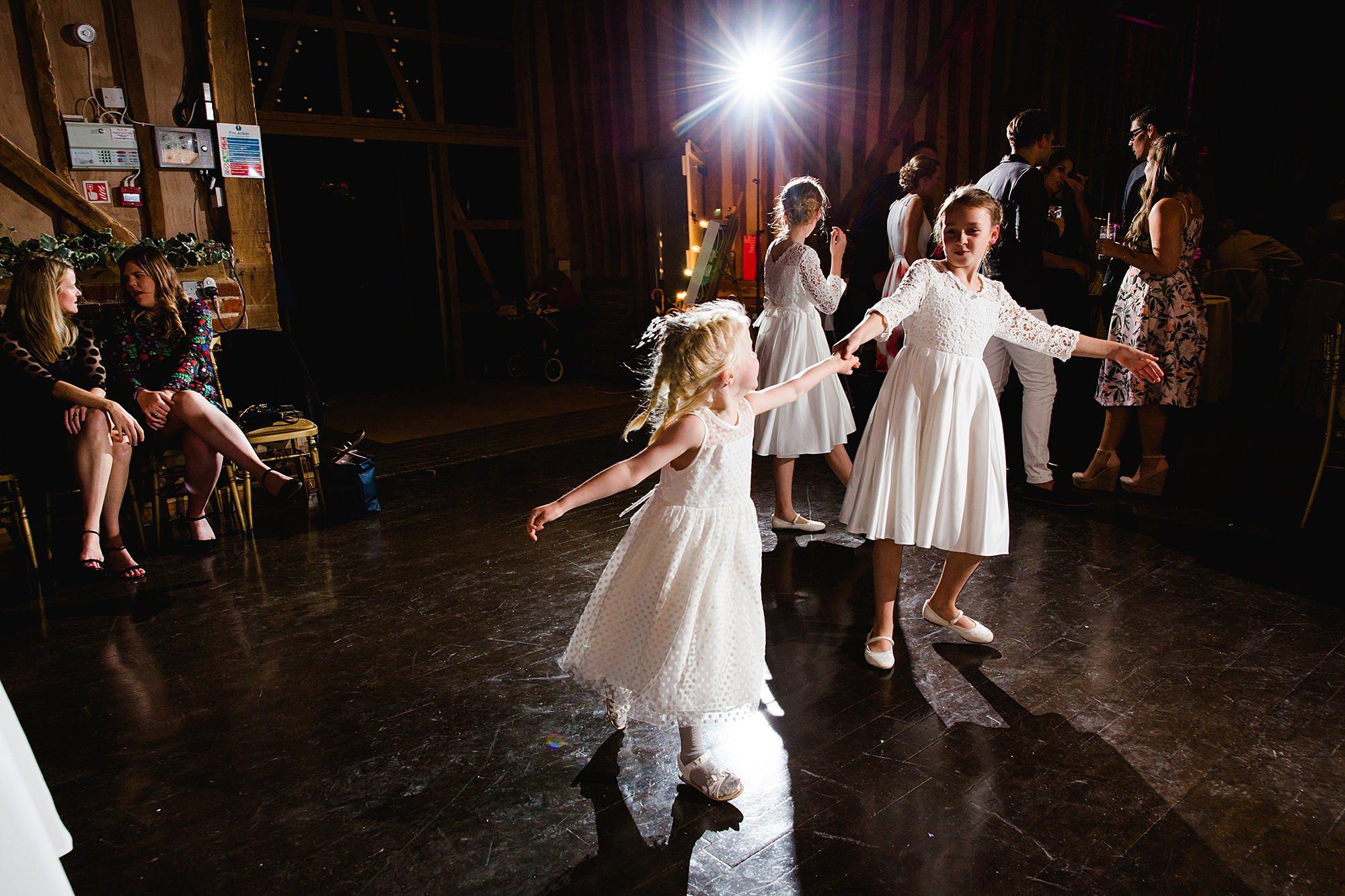 Lillibrooke Manor wedding flower girls dance together