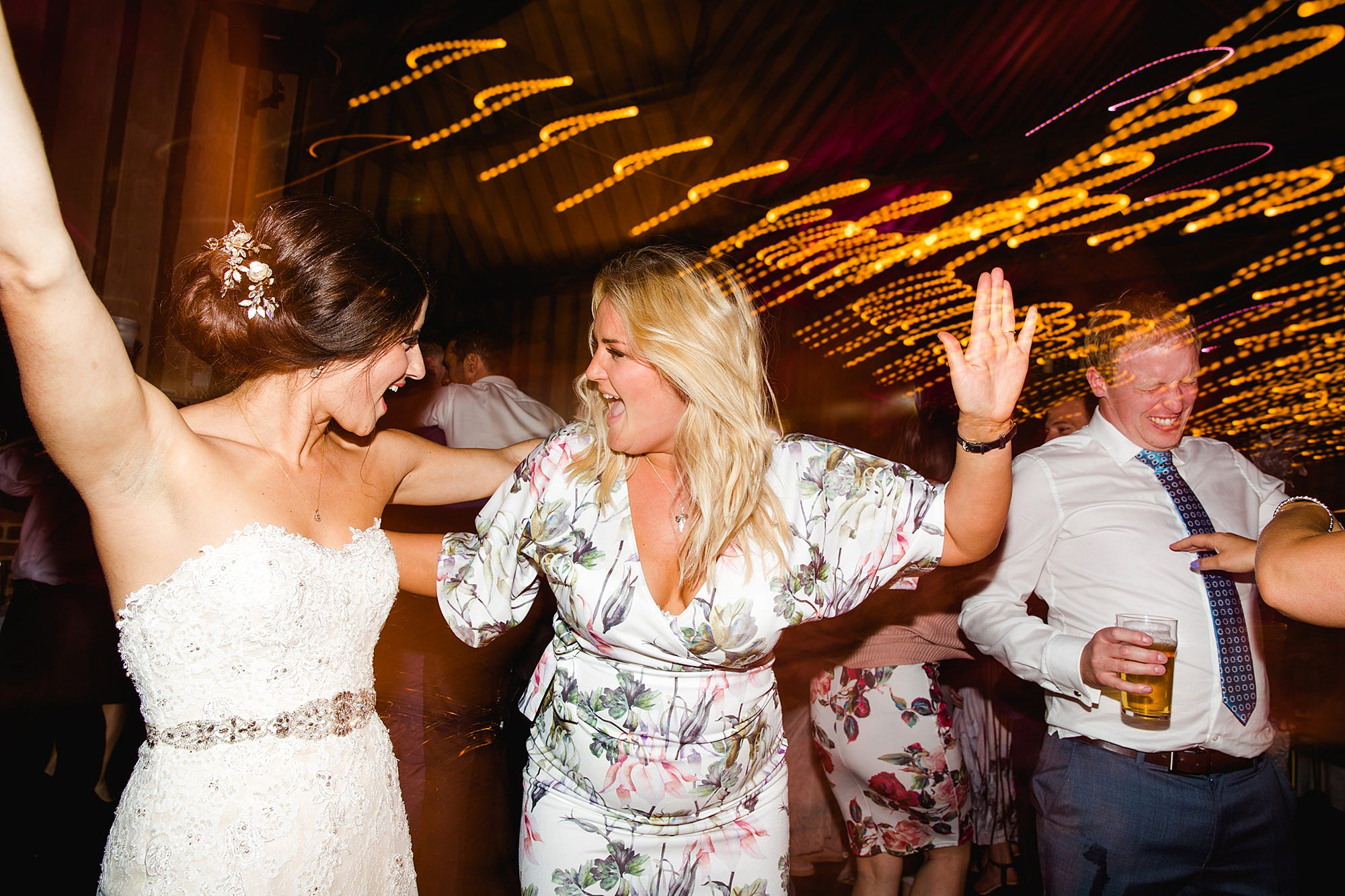 Lillibrooke Manor wedding bride and guest dancing