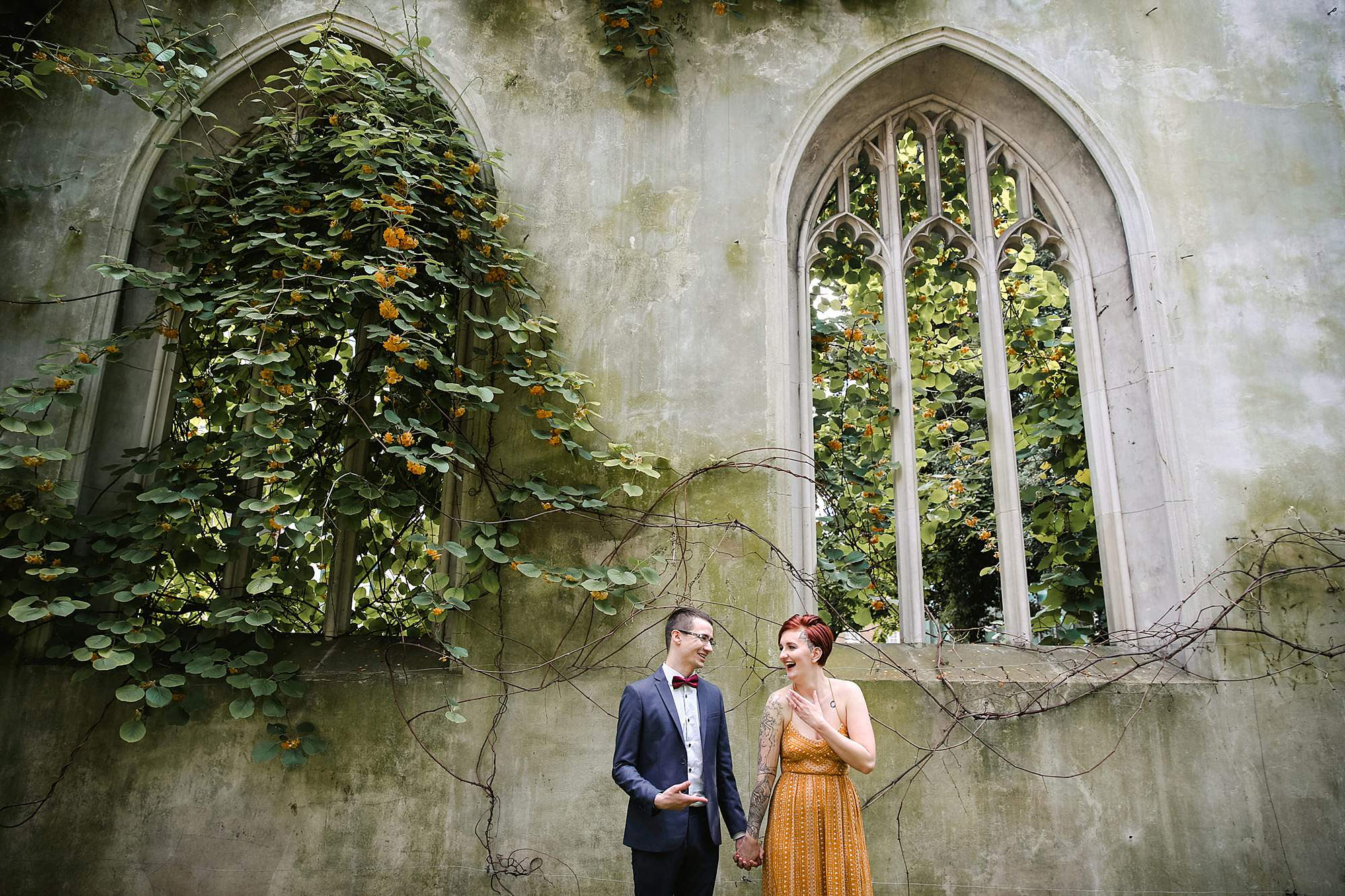 london engagement session couple in front of church window
