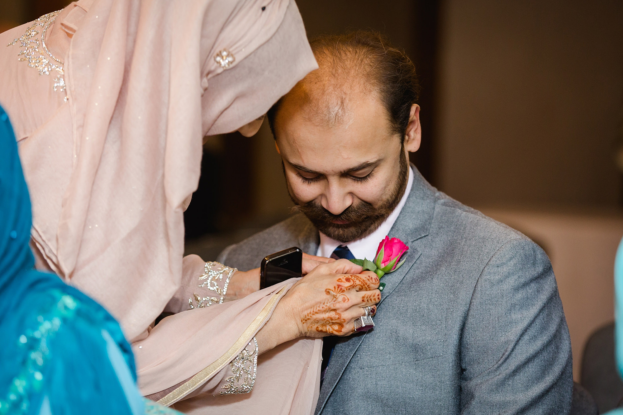 Richmond Hill Hotel wedding photography guest having buttonhole pinned