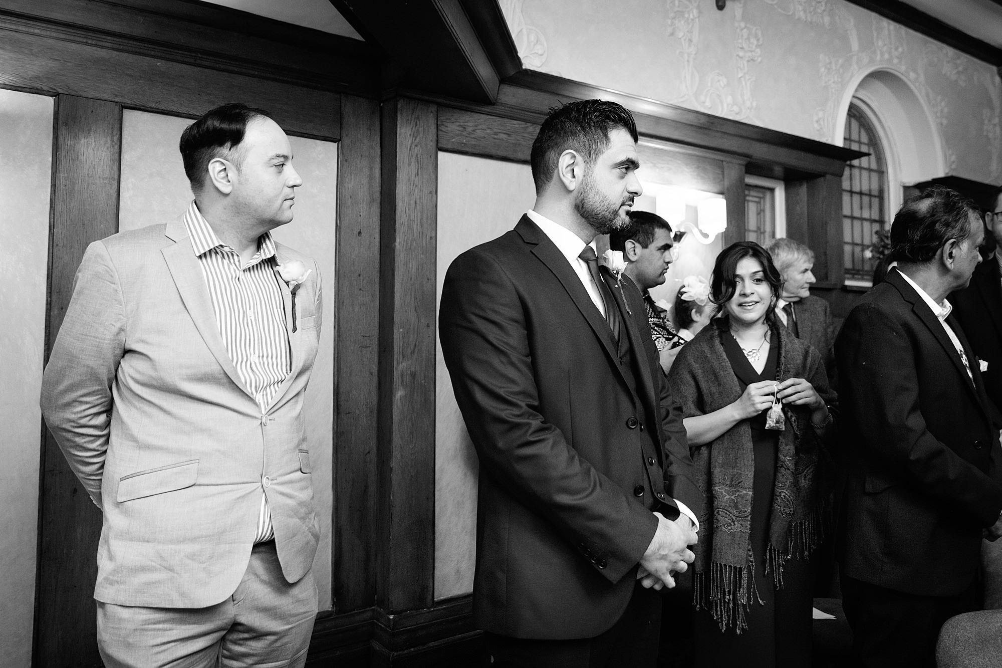 Richmond Hill Hotel wedding photography groom waits for bride's entrance