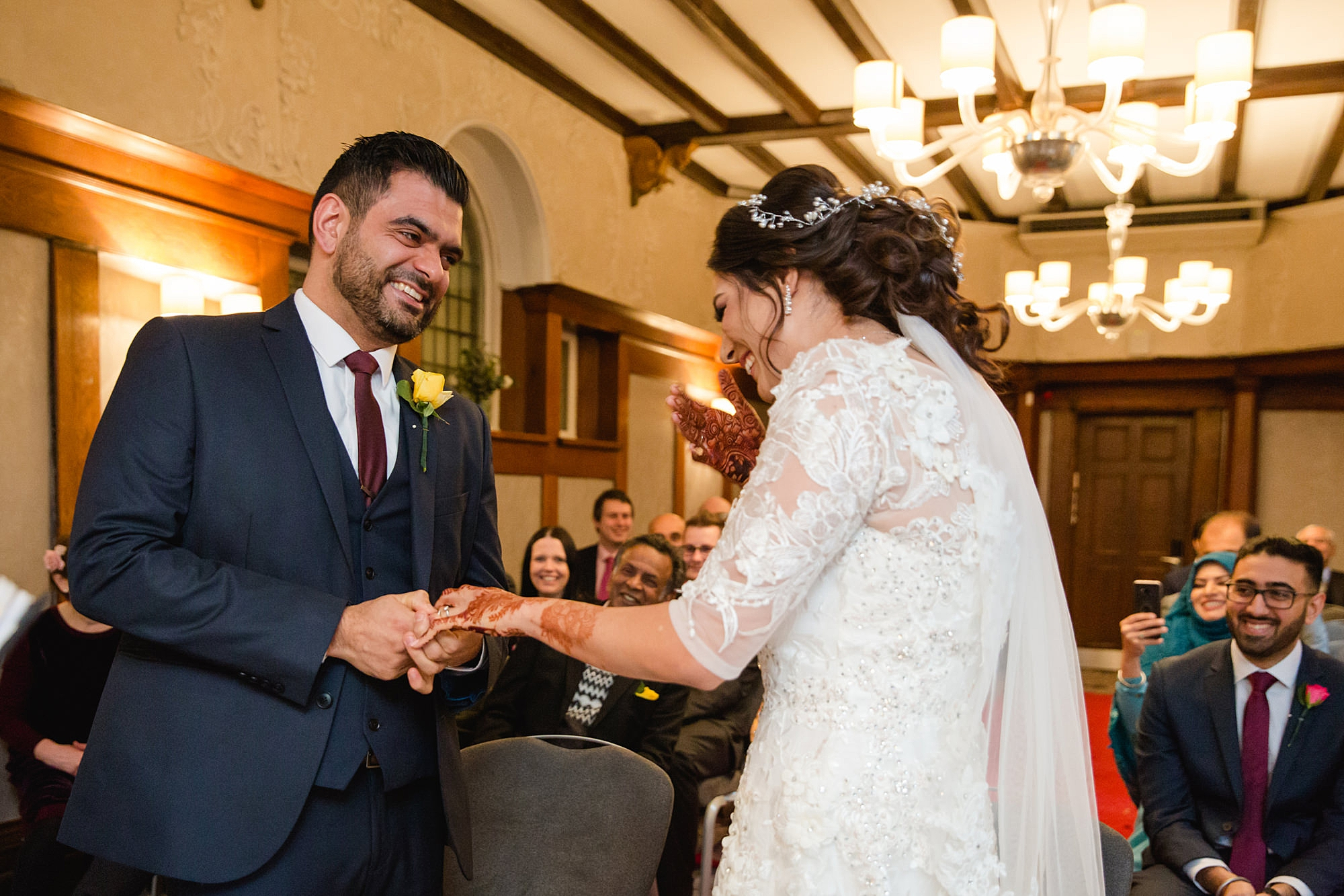 Richmond Hill Hotel wedding photography bride and groom laughing during ceremony