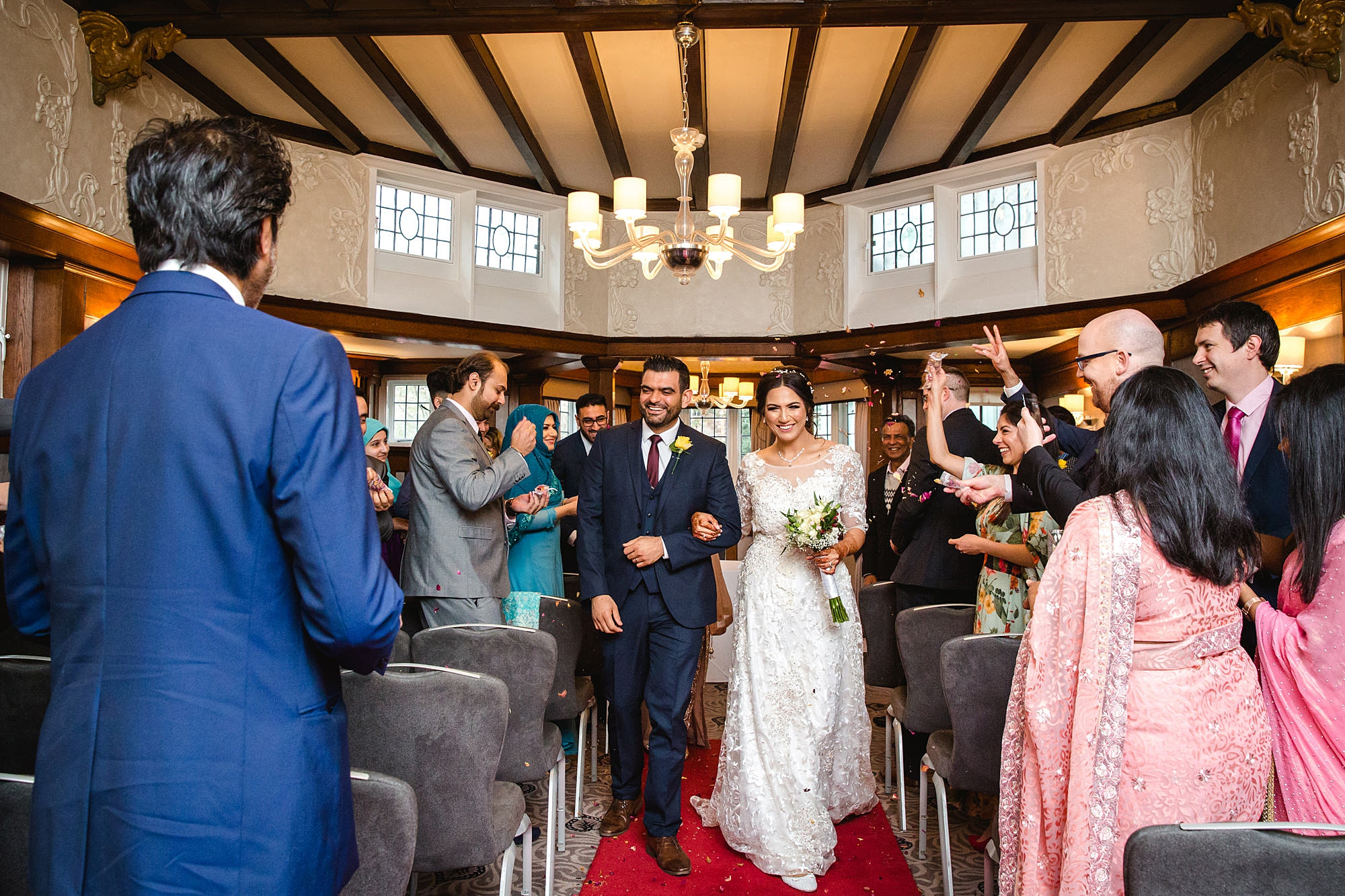 Richmond Hill Hotel wedding photography bride and groom walk back down the aisle
