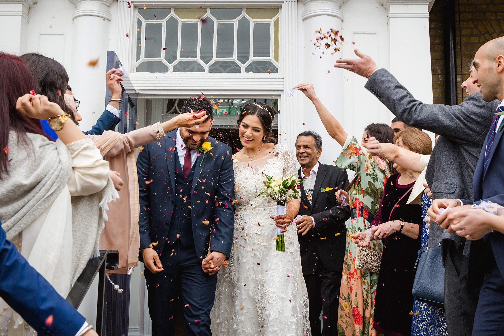 Richmond Hill Hotel wedding photography bride and groom with confetti
