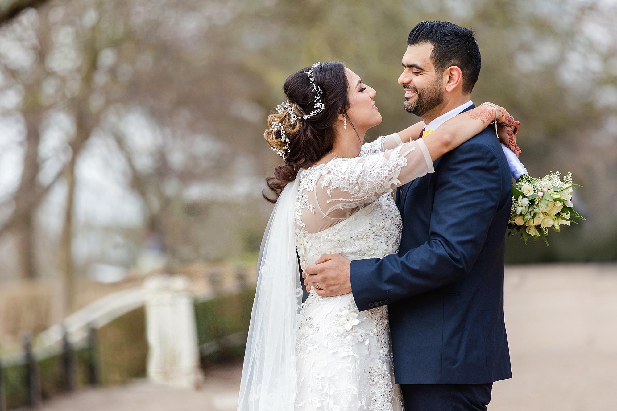 Richmond Hill Hotel wedding photography bride and groom hug on richmond hill terrace
