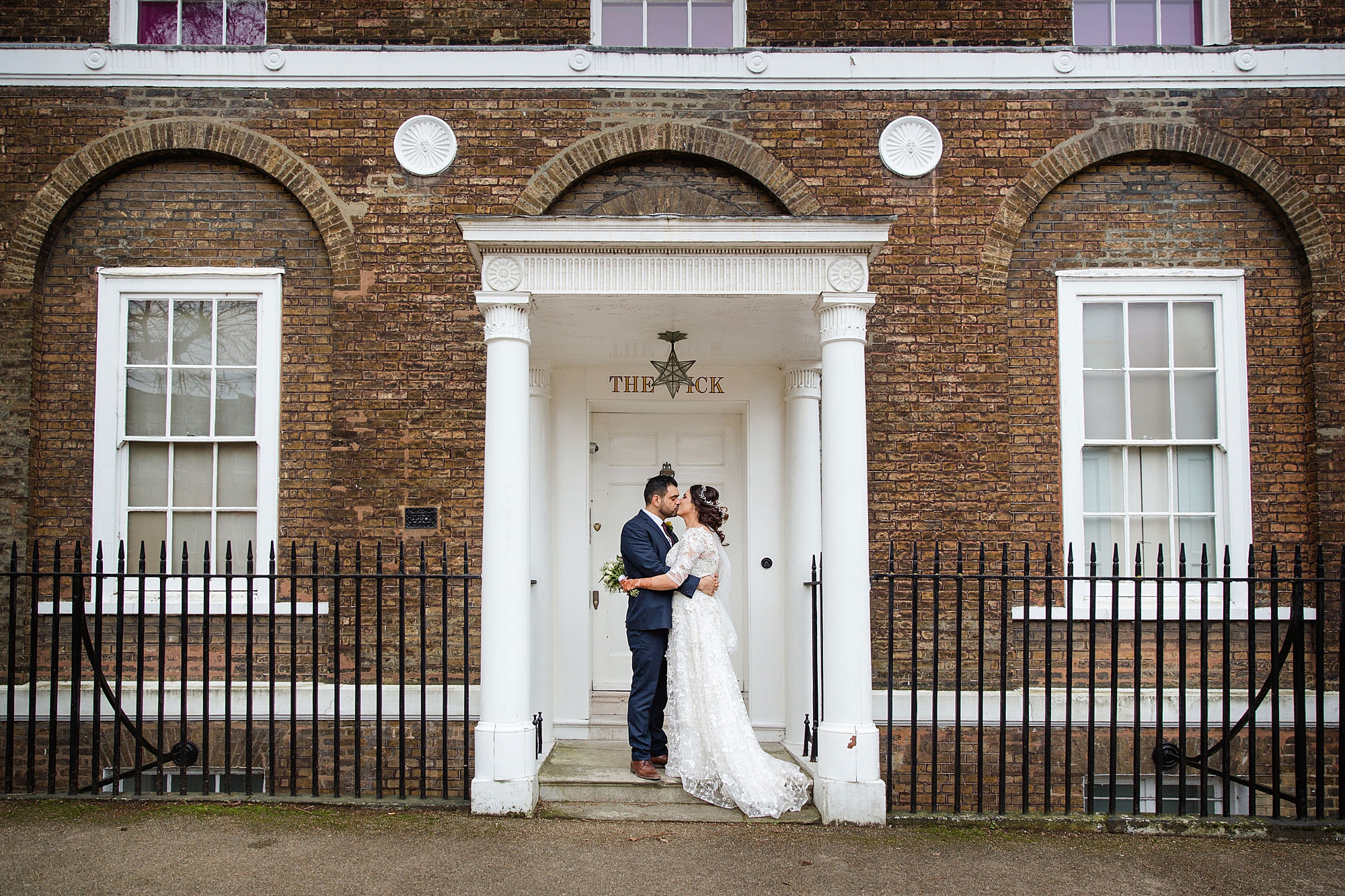 Richmond Hill Hotel wedding portrait of bride and groom in doorway