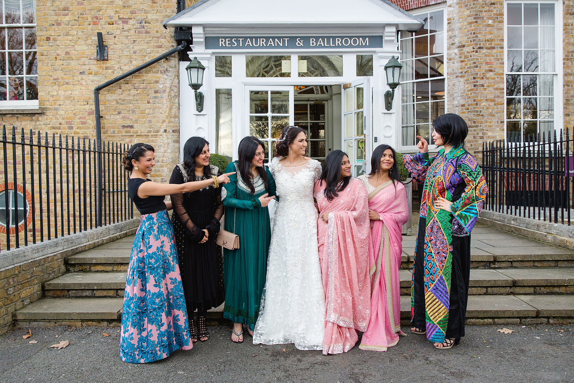 Richmond Hill Hotel wedding bride and her friends laughing together