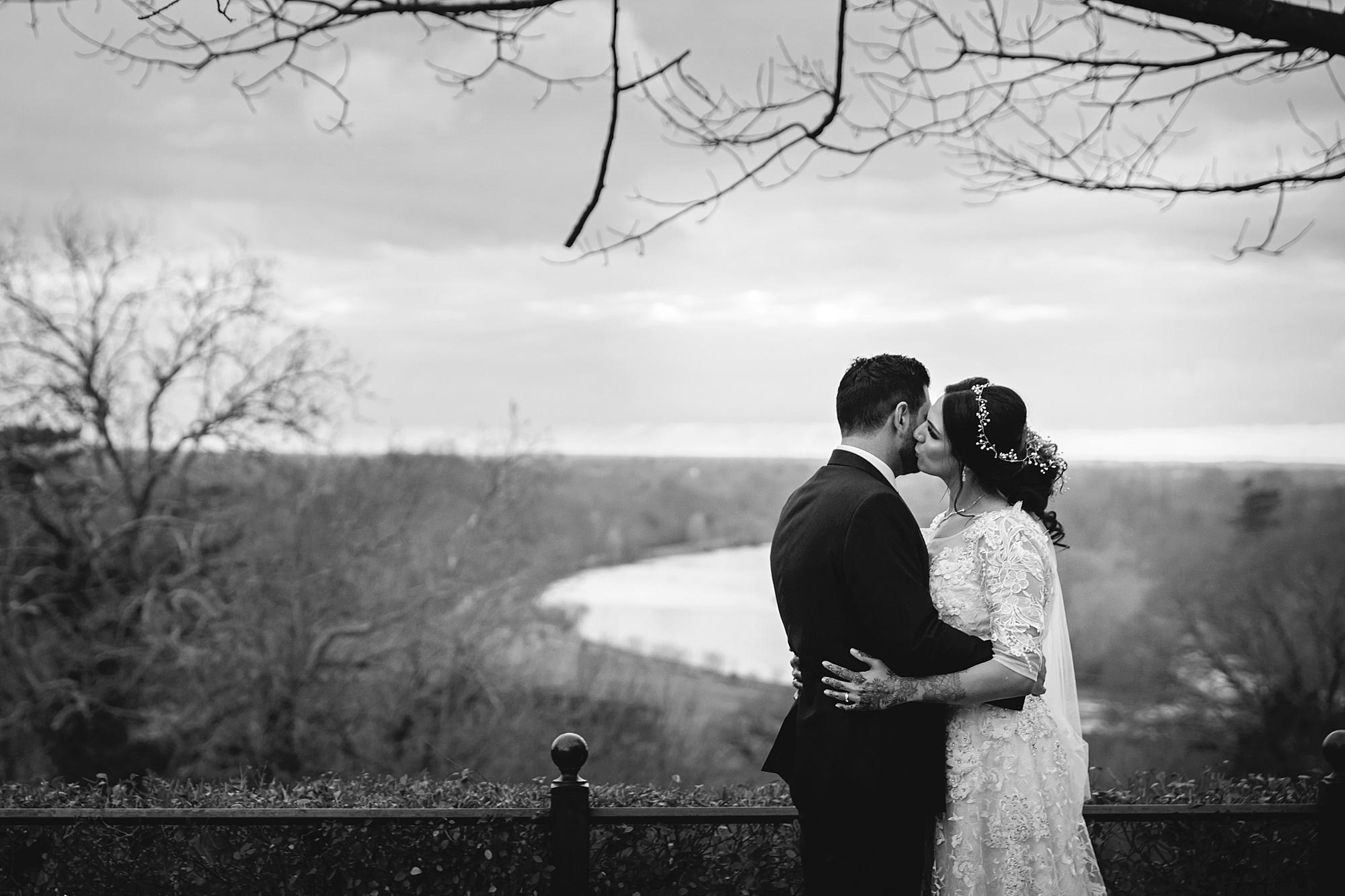 Richmond Hill Hotel wedding bride kisses groom