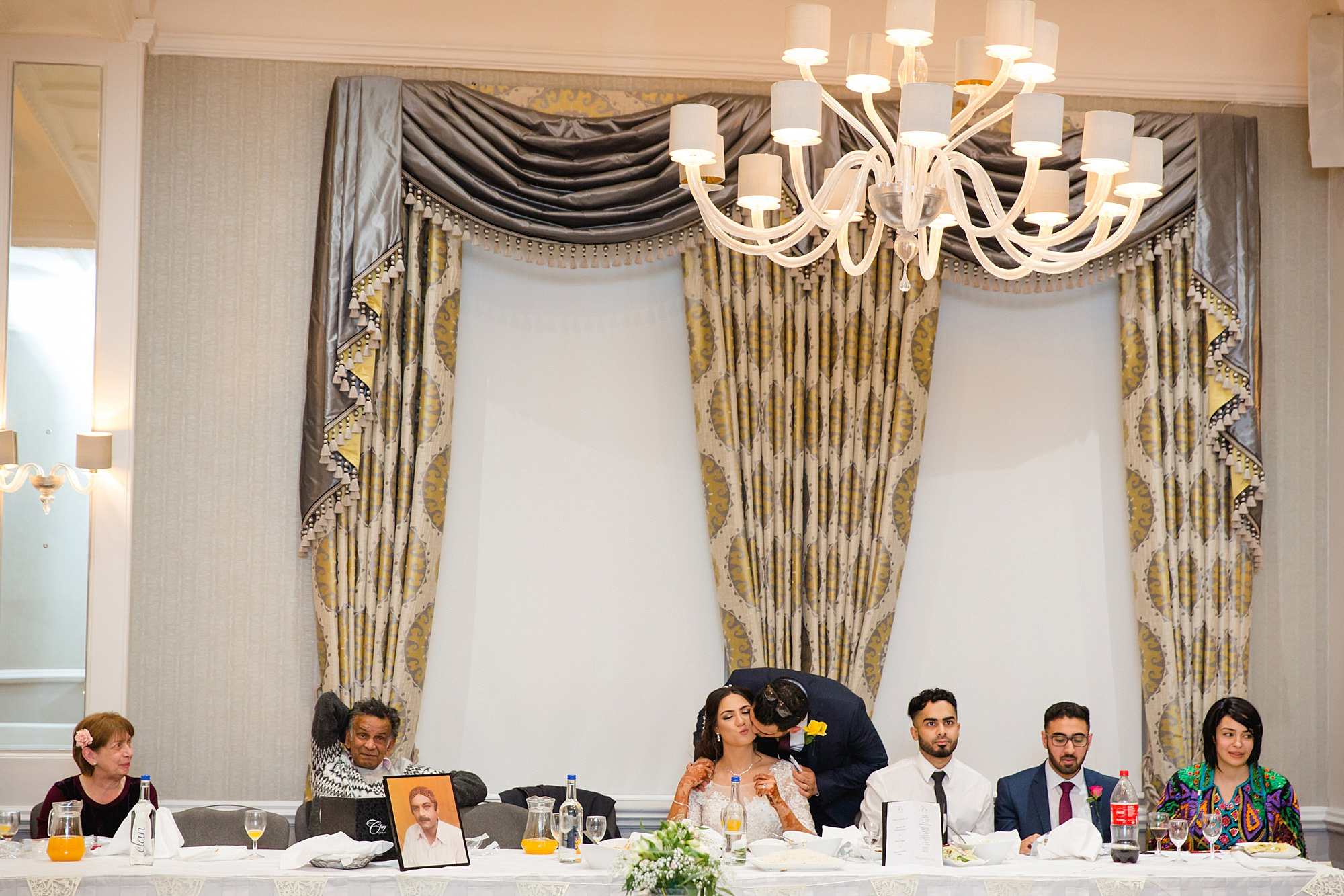 Richmond Hill Hotel wedding groom kisses bride during speeches