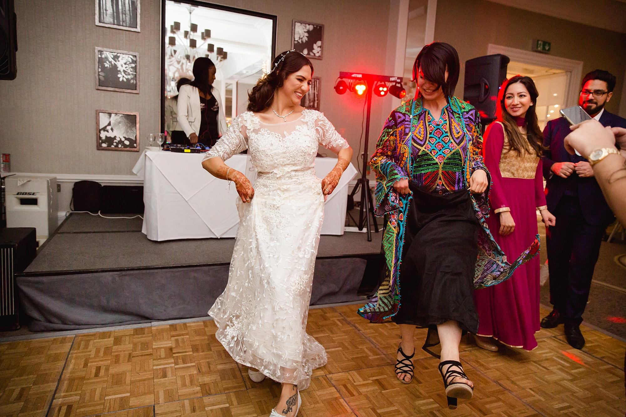 Richmond Hill Hotel wedding bride dancers with her friend