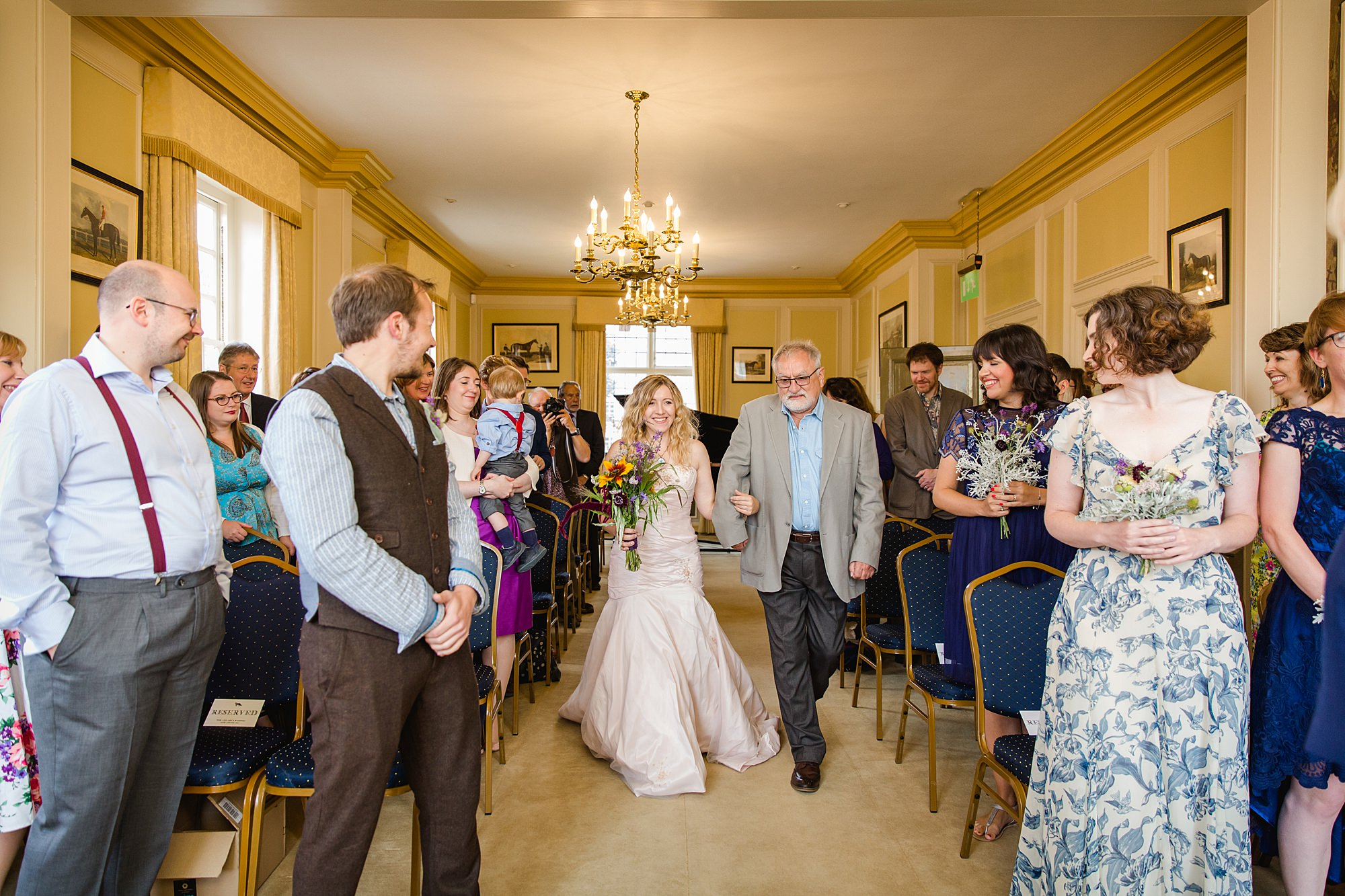 Fun village hall wedding bride walks down the aisle at edes house