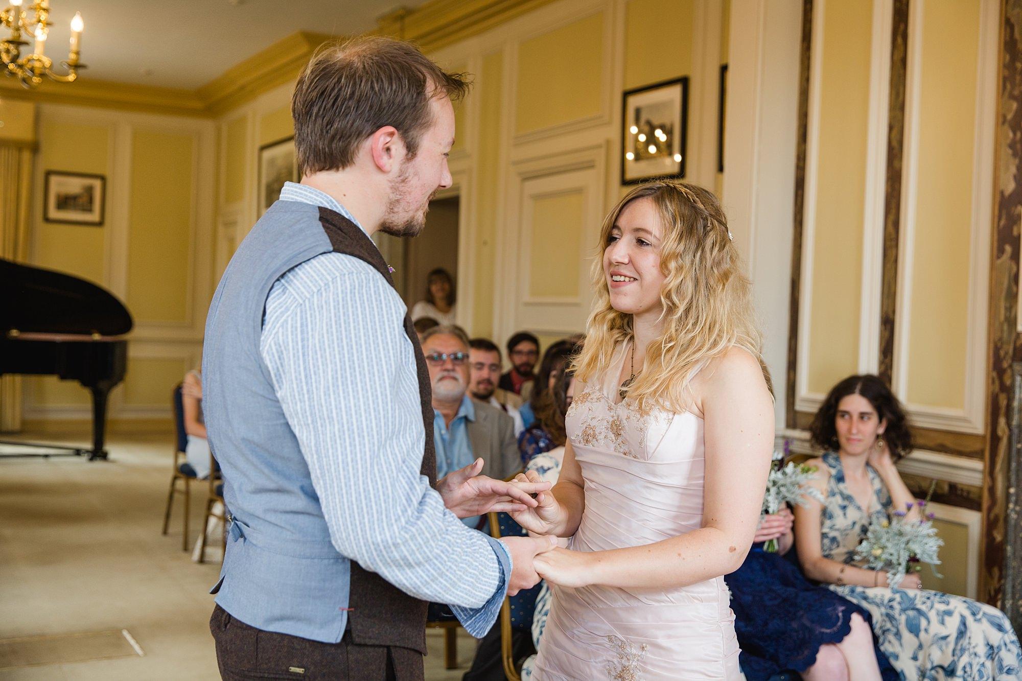 Fun village hall wedding bride and groom say vows at wedding ceremony