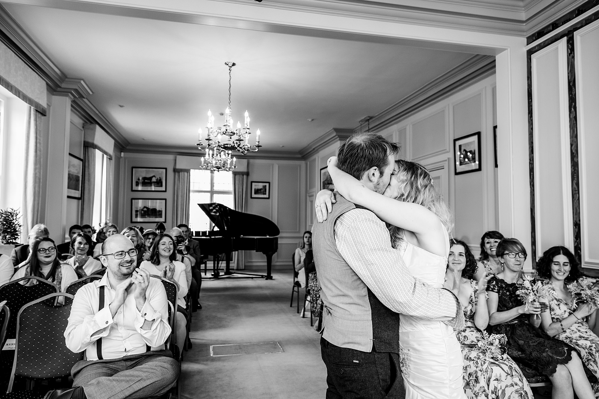 Fun village hall wedding bride and groom's first kiss