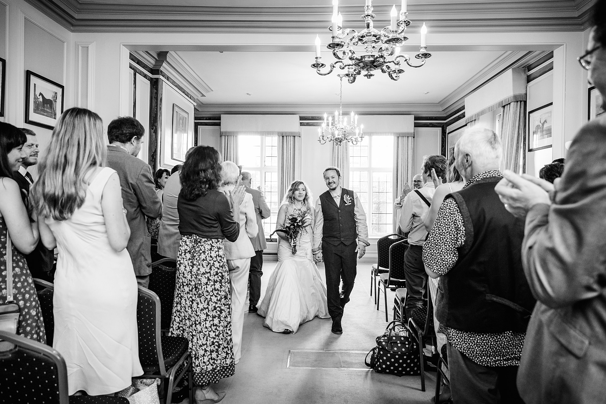 Fun village hall wedding bride and groom walk back down the aisle at edes House