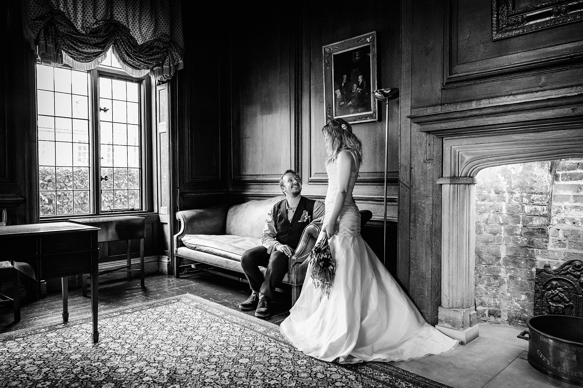 Fun village hall wedding portrait of bride and groom in a room at Edes House