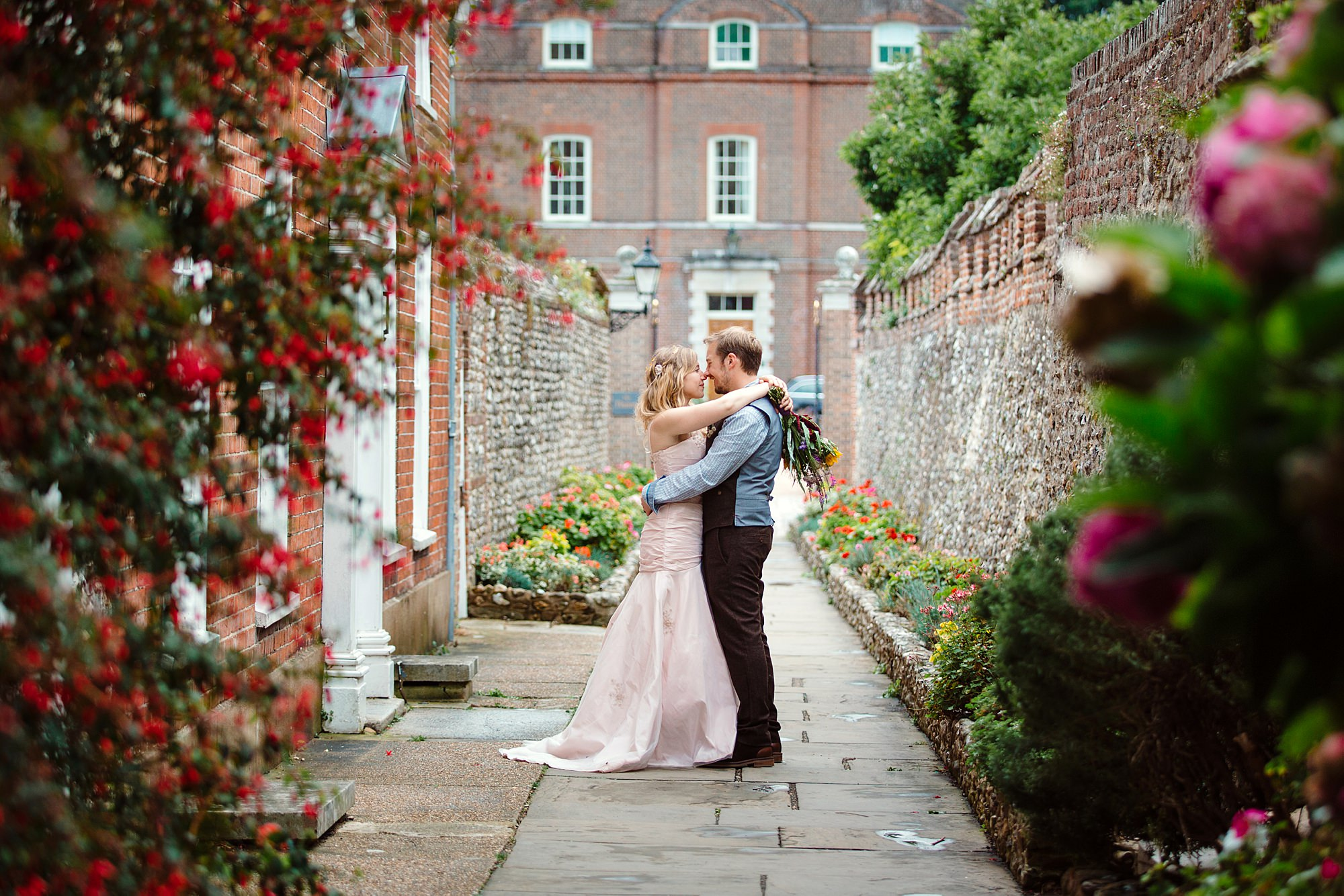 Fun village hall wedding bride and groom in cathedral walkway