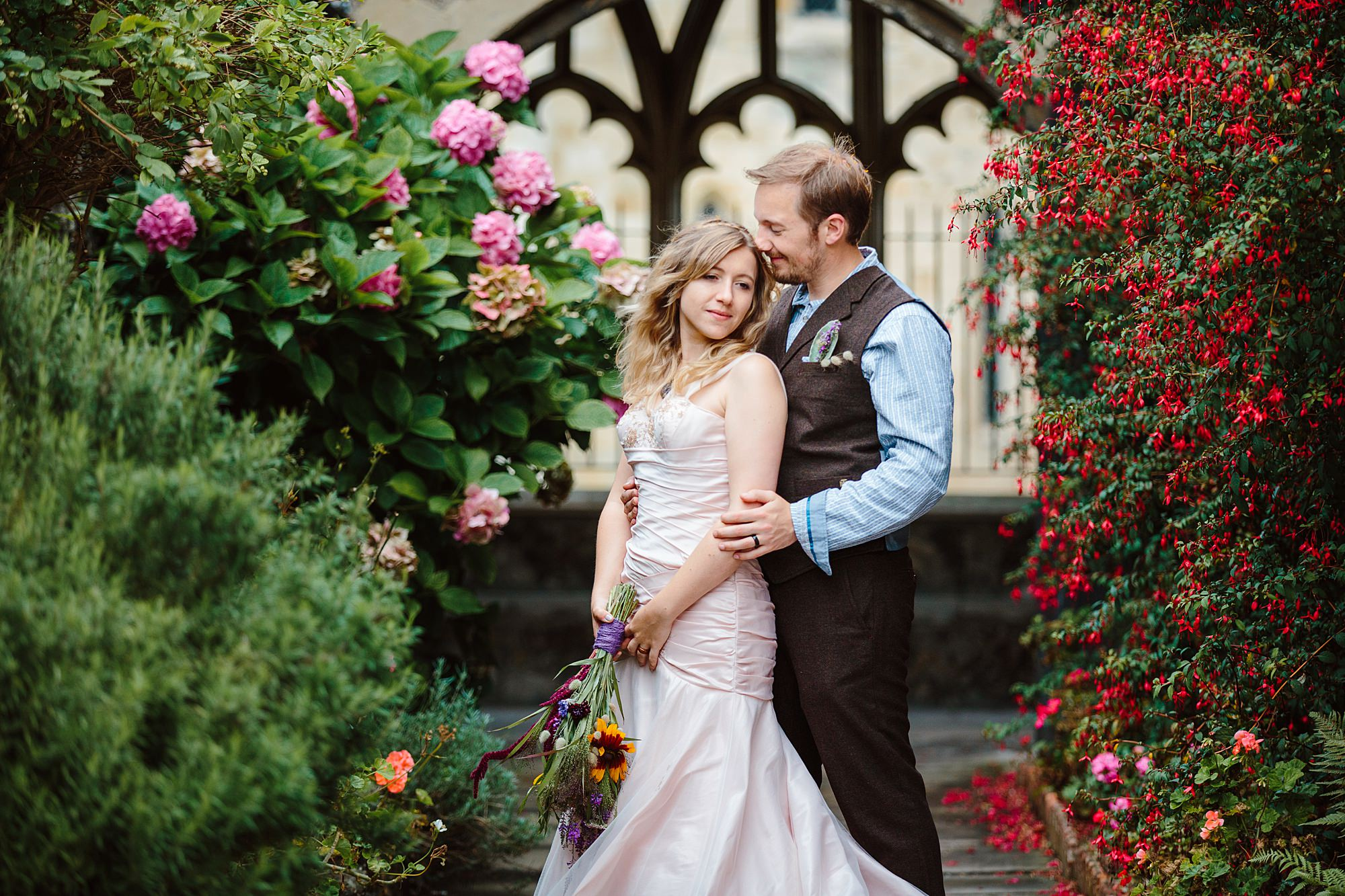 Fun village hall wedding portrait of bride and groom at chichester cathedral