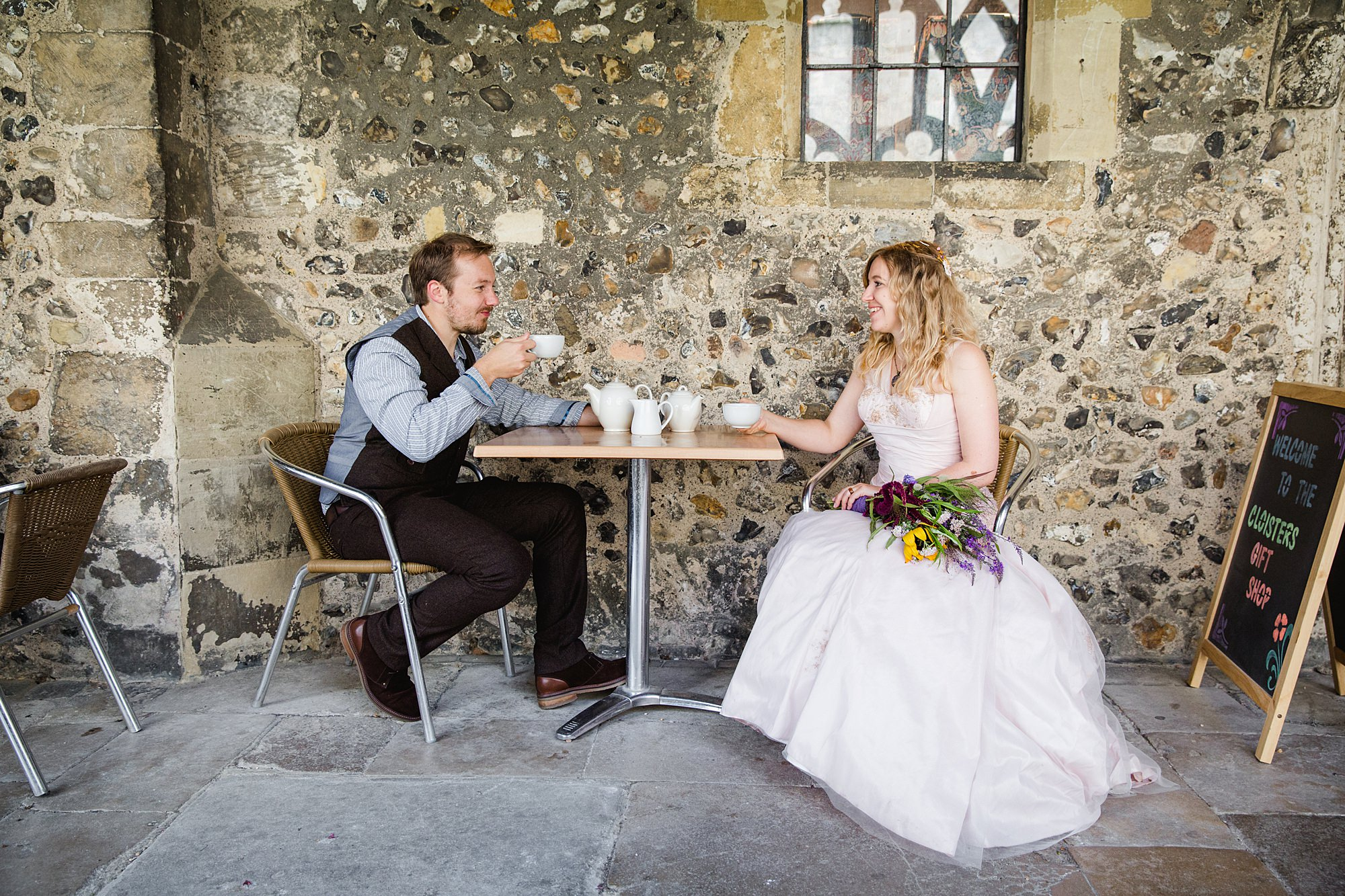 Fun village hall wedding bride and groom enjoy a cup of tea together