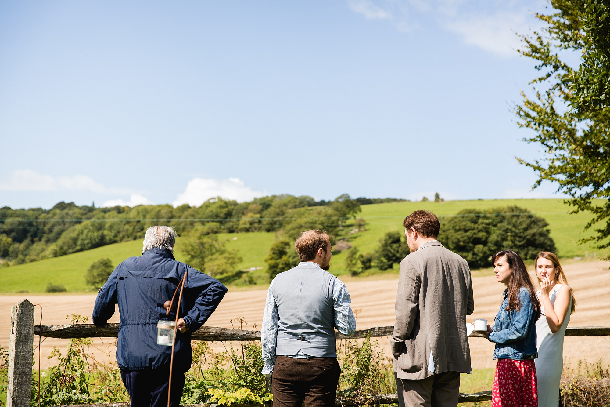 Fun village hall wedding guests looking over fields