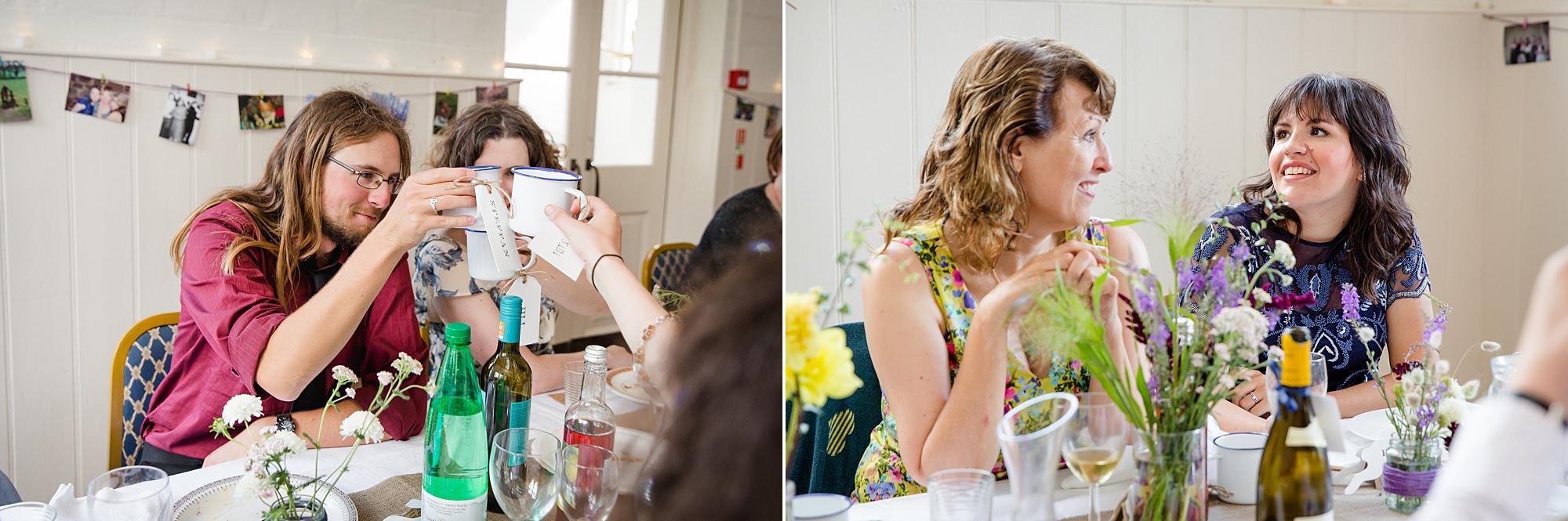Fun village hall wedding guests make a toast