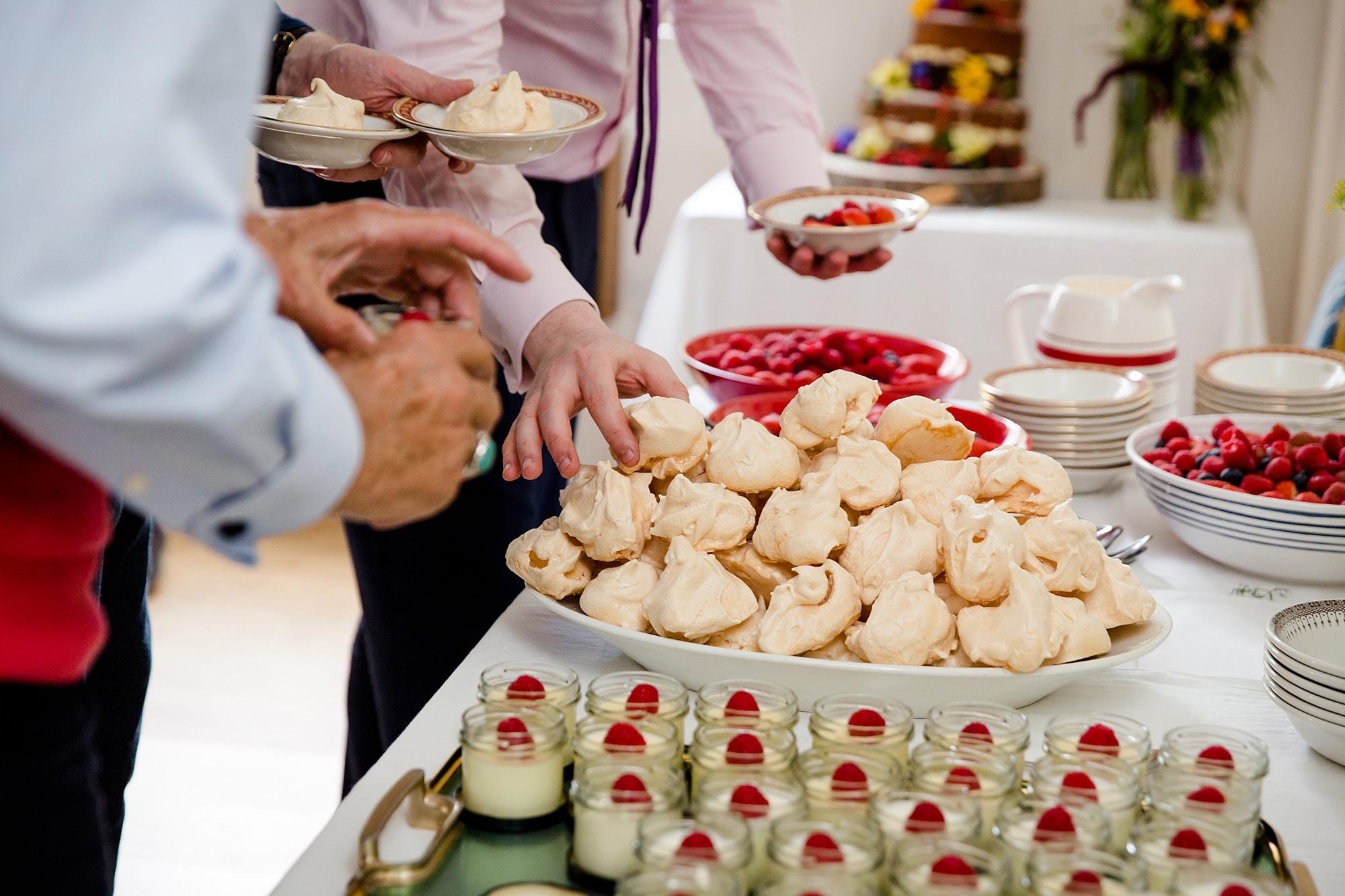 Fun village hall wedding guests help themselves to dessert