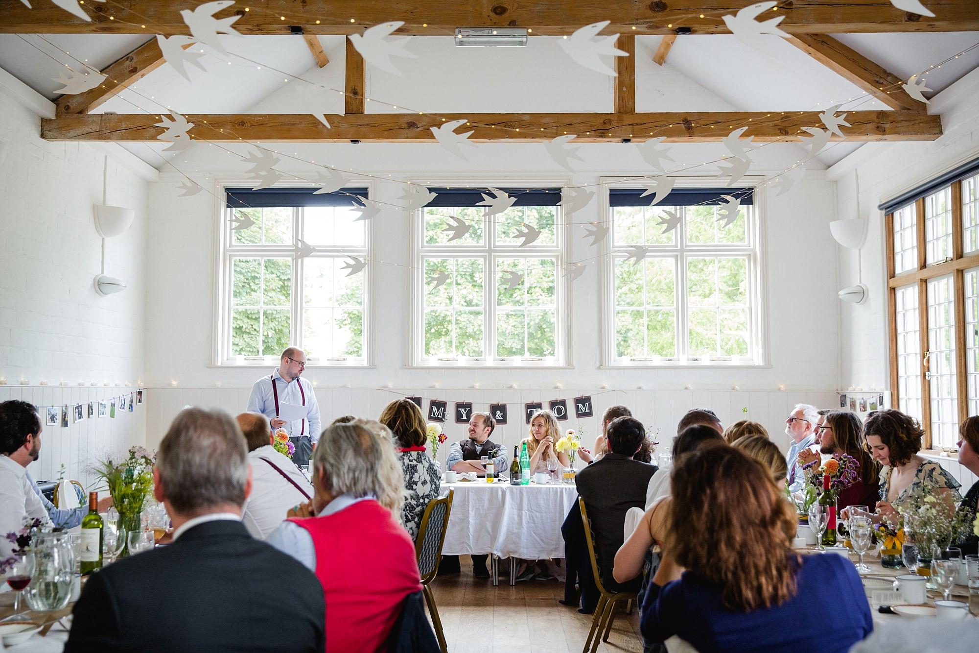 Fun village hall wedding best man giving speech