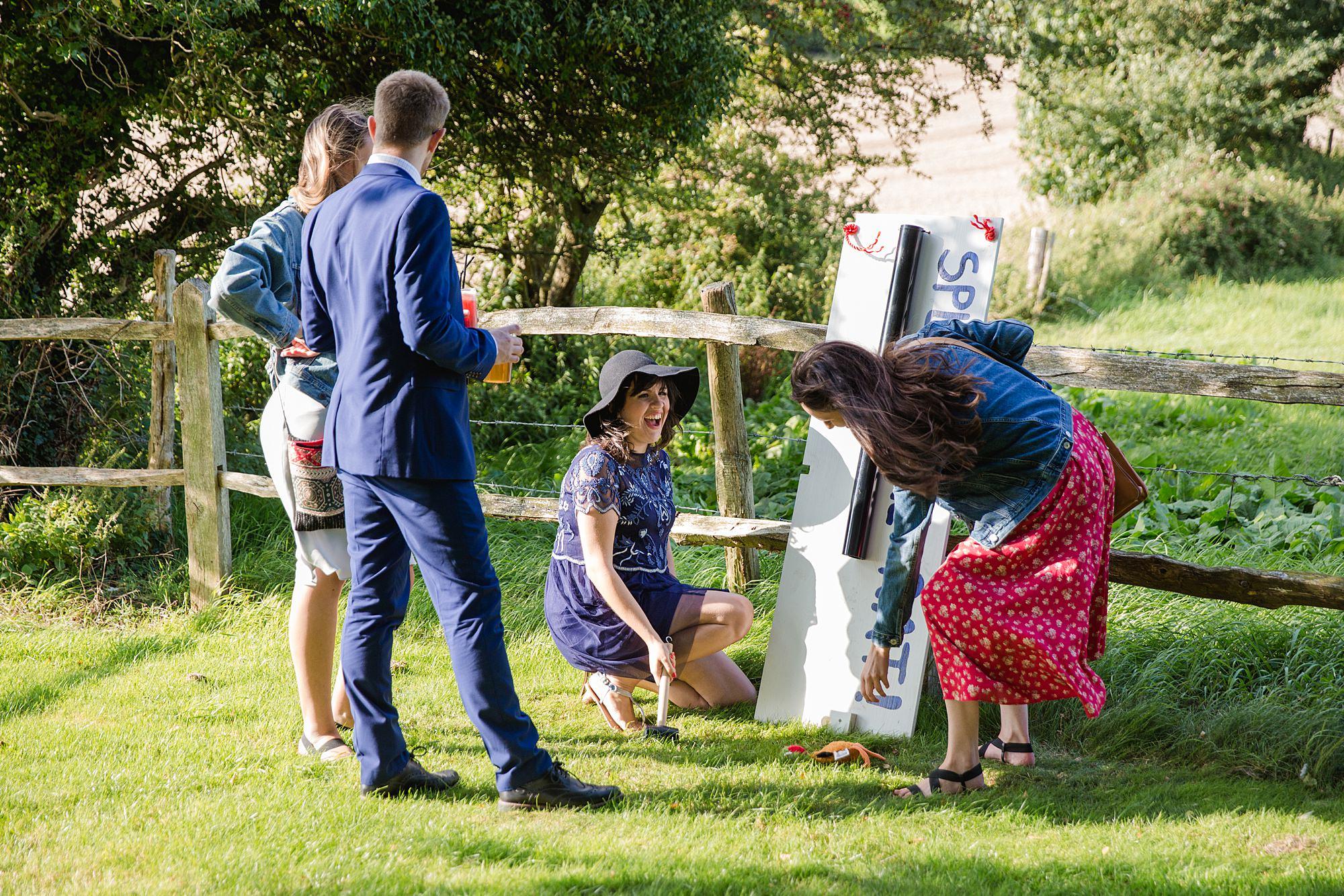 Fun village hall wedding guests play splat the rat