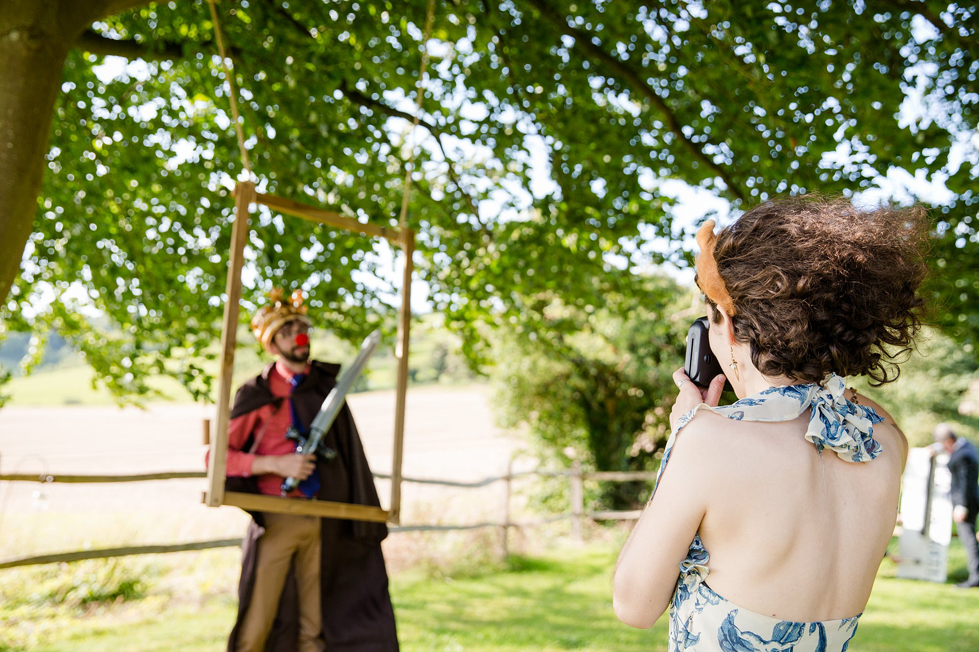 Fun village hall wedding guests dress up with props