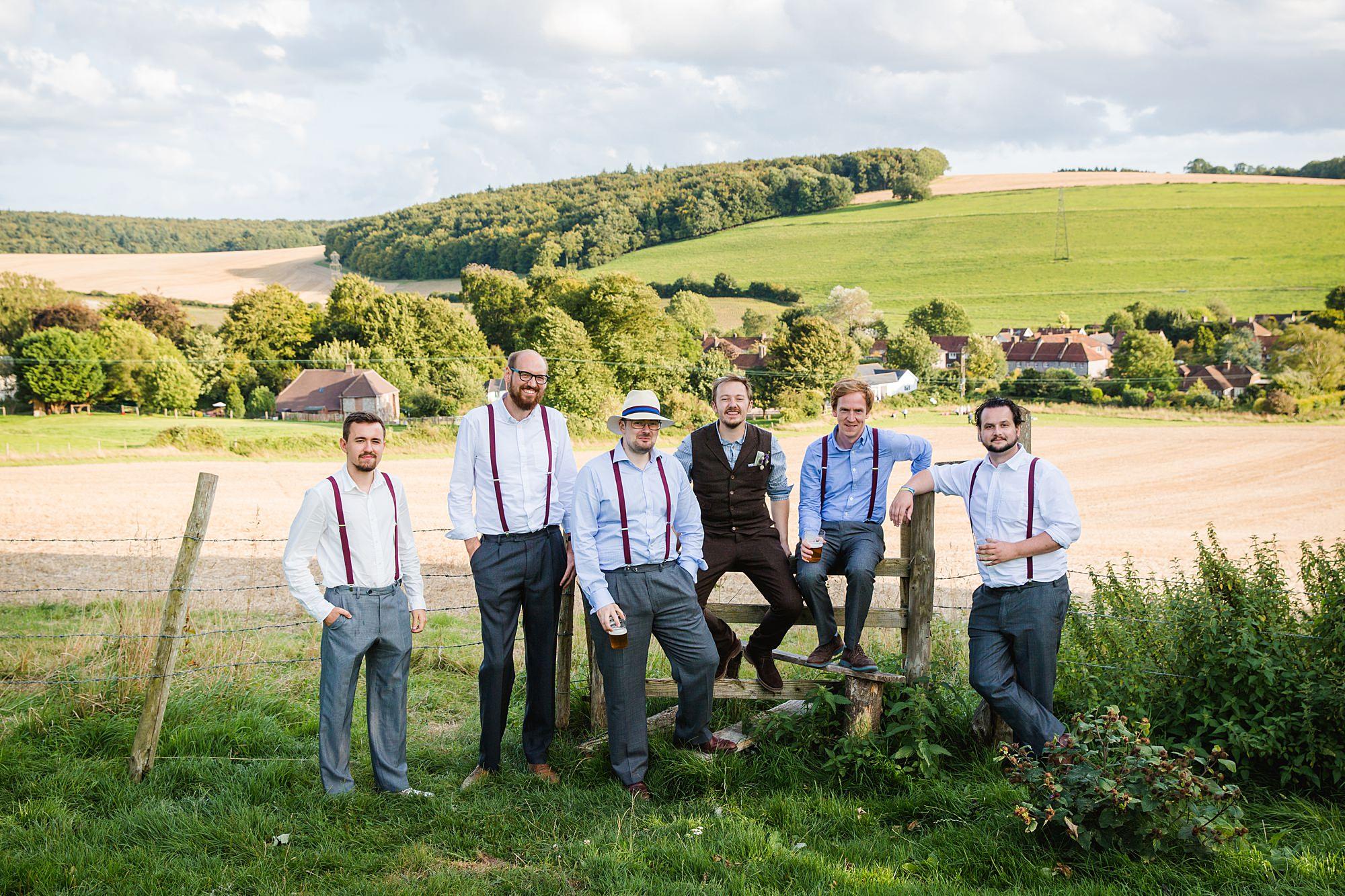 Fun village hall wedding laid back portrait of groom and groomsmen