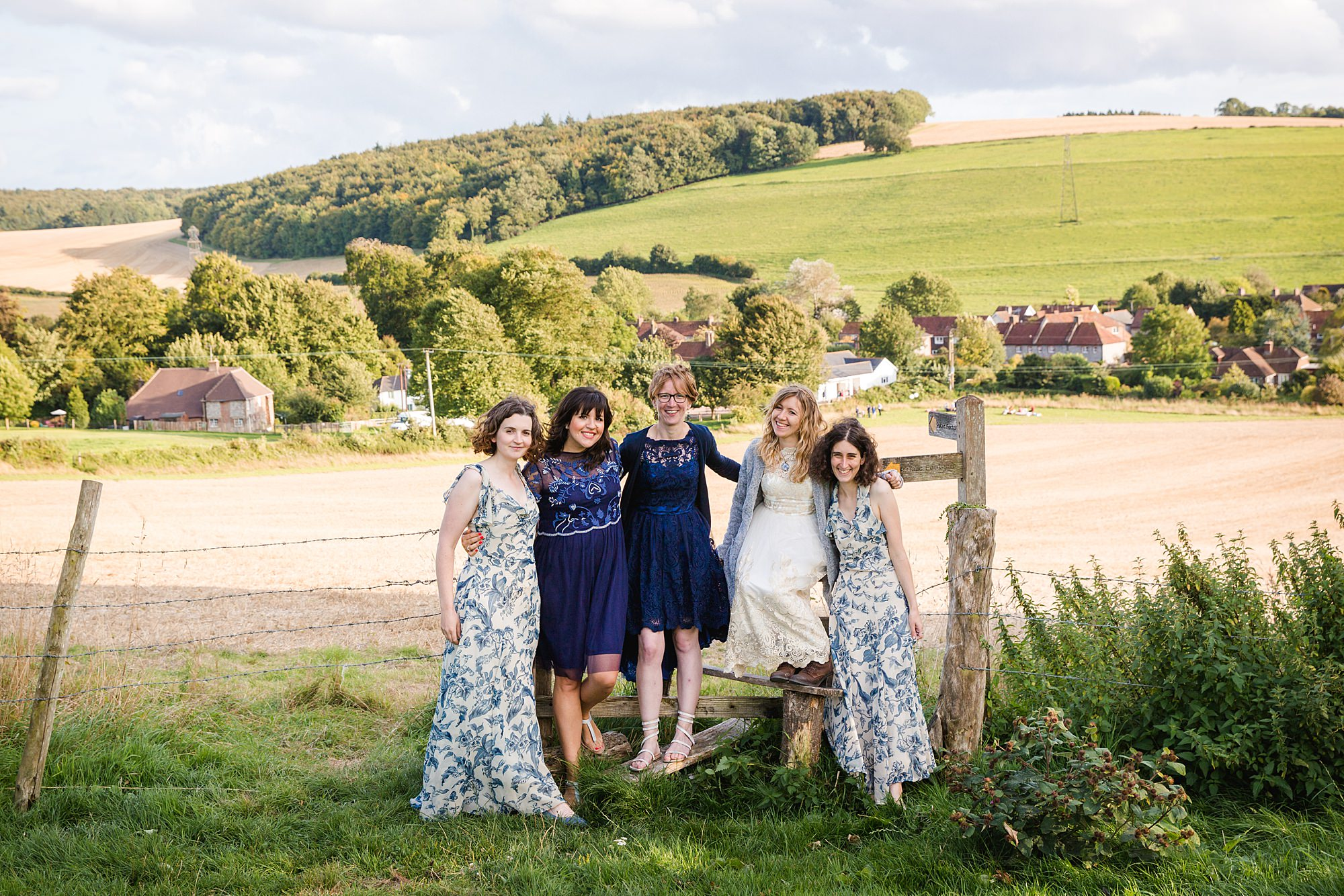 Fun village hall wedding bride and bridesmaids laid back portrait together