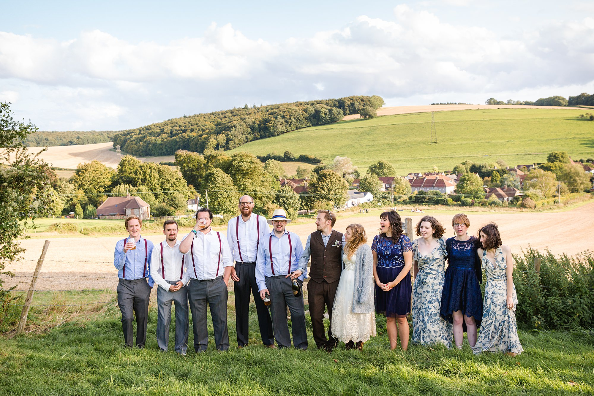Fun village hall wedding fun portrait of bride and groom's party together
