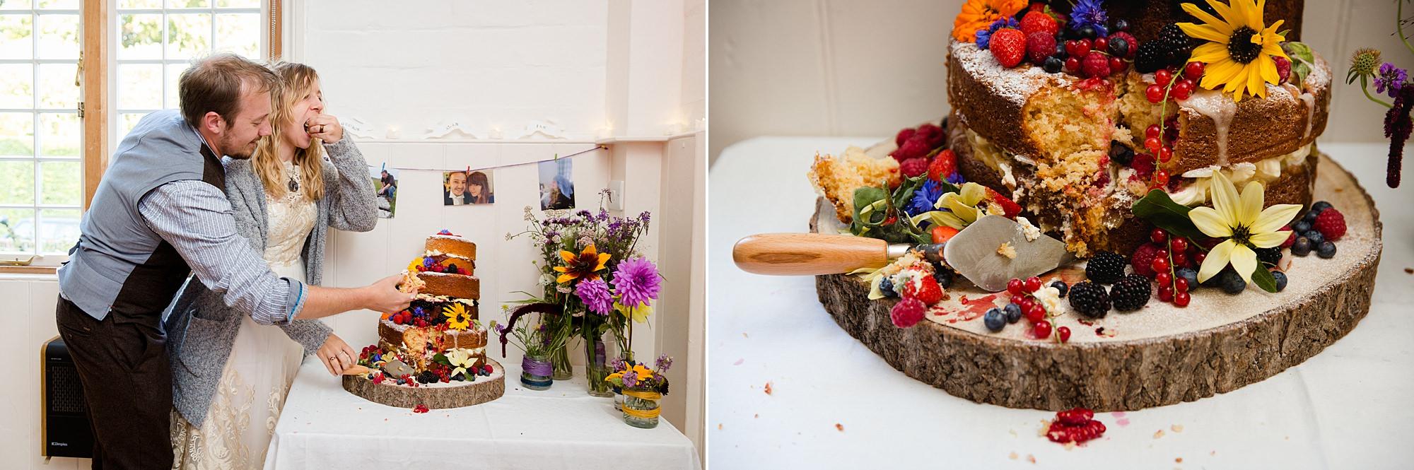 Fun village hall wedding bride and groom cut wedding cake with a trowel