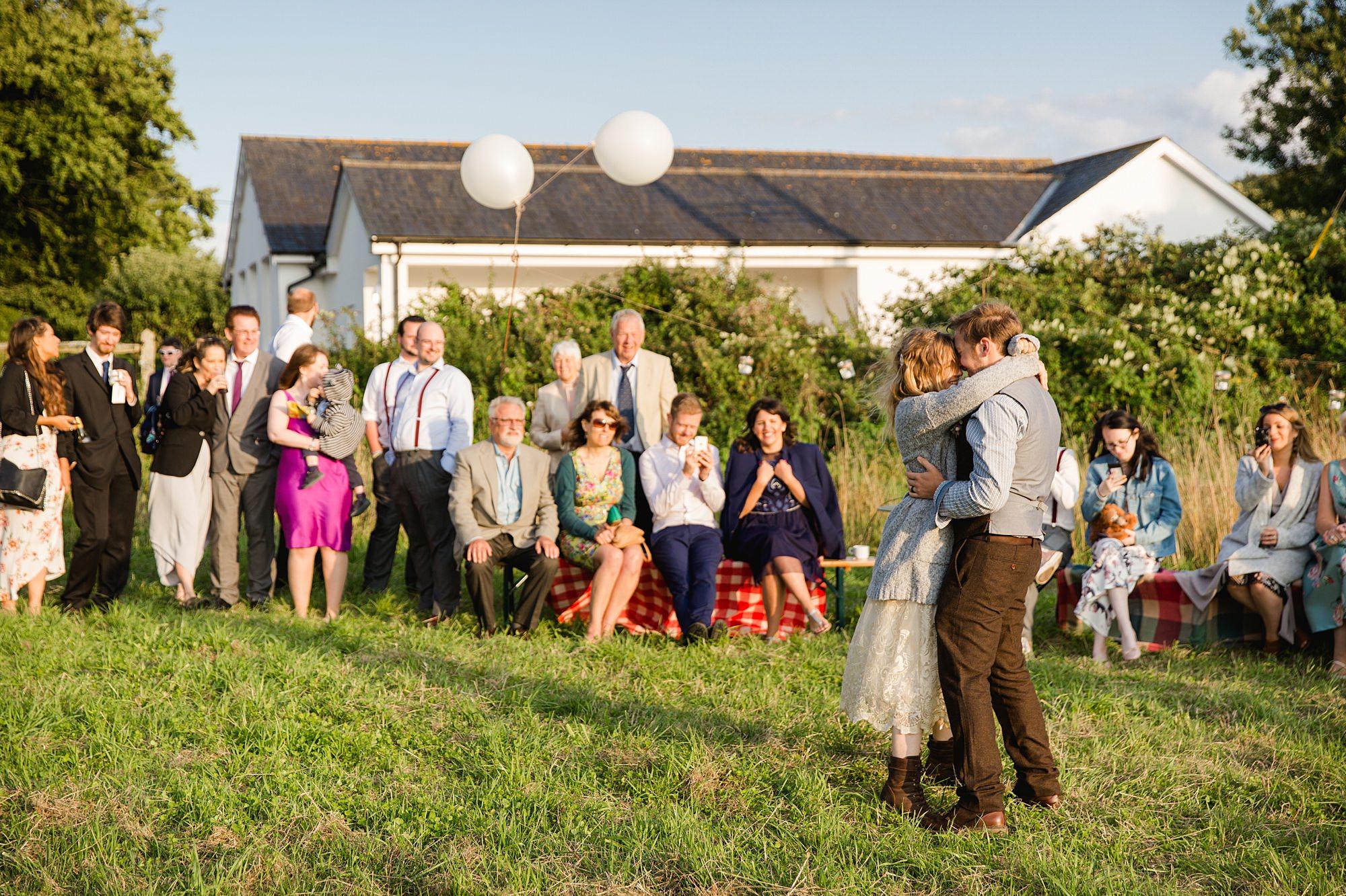 Fun village hall wedding outdoor first dance