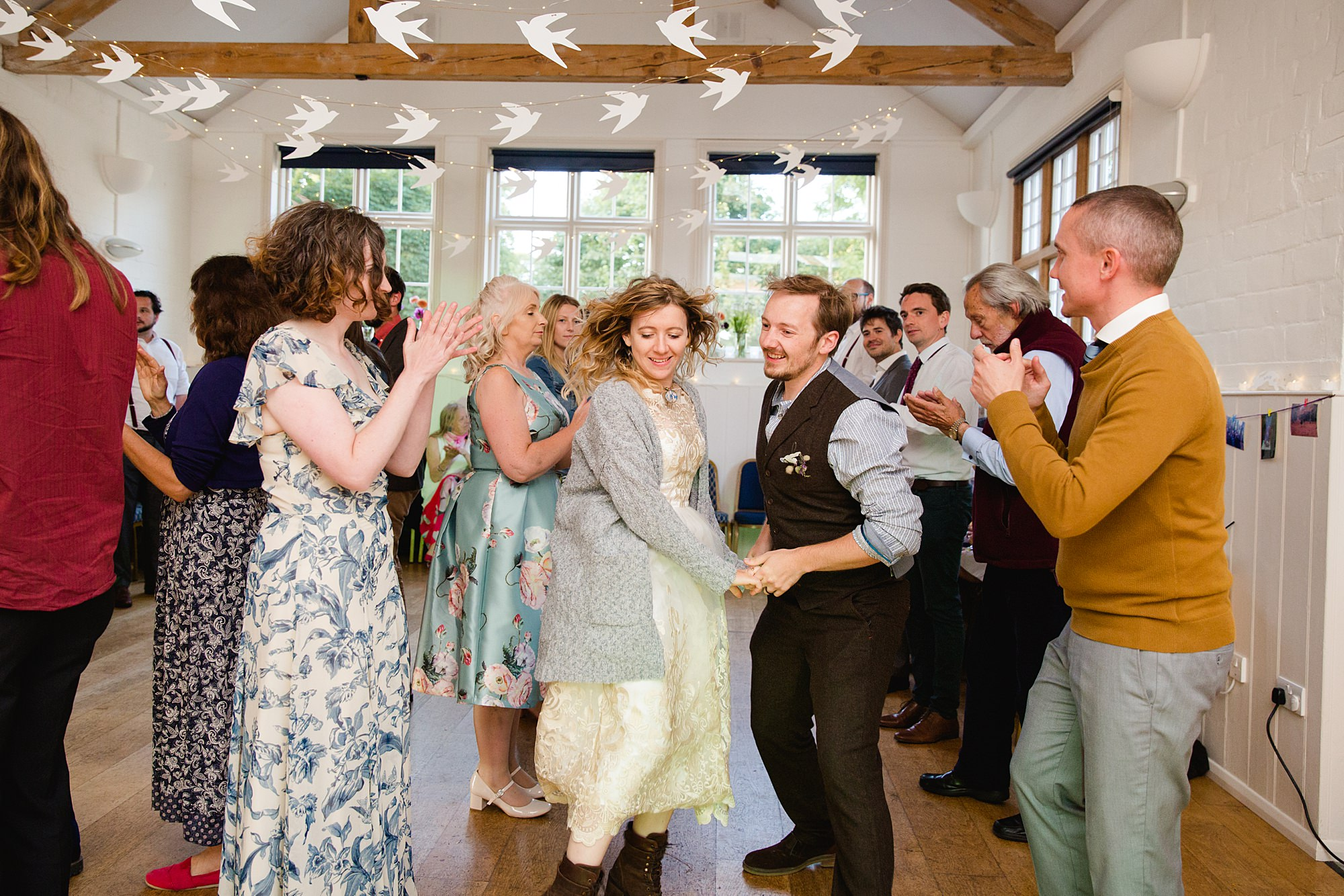 Fun village hall wedding ceilidh dancing