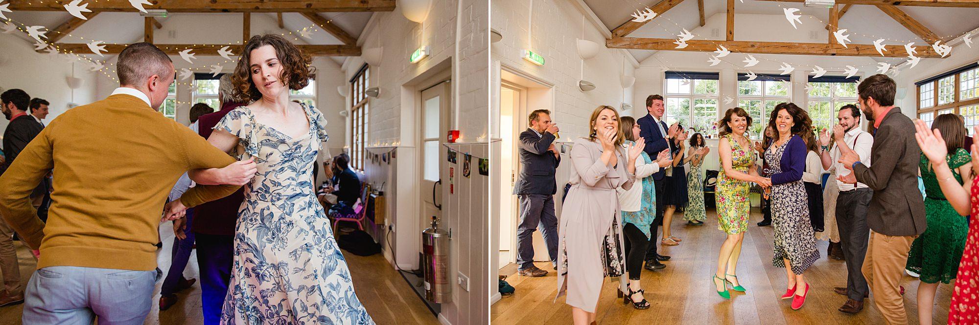 Fun village hall wedding guests dancing a ceiling