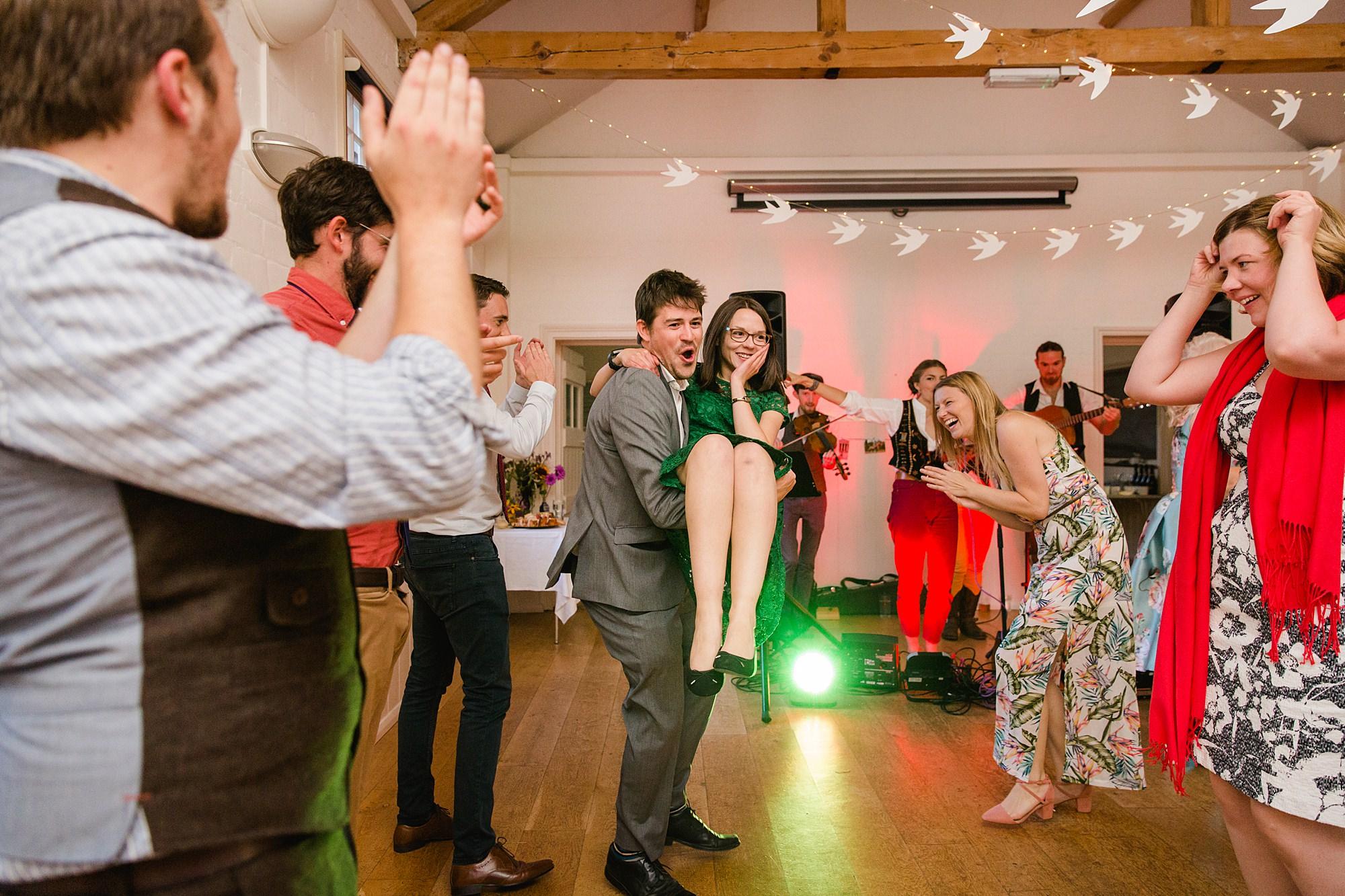 Fun village hall wedding guests dancing ceilidh