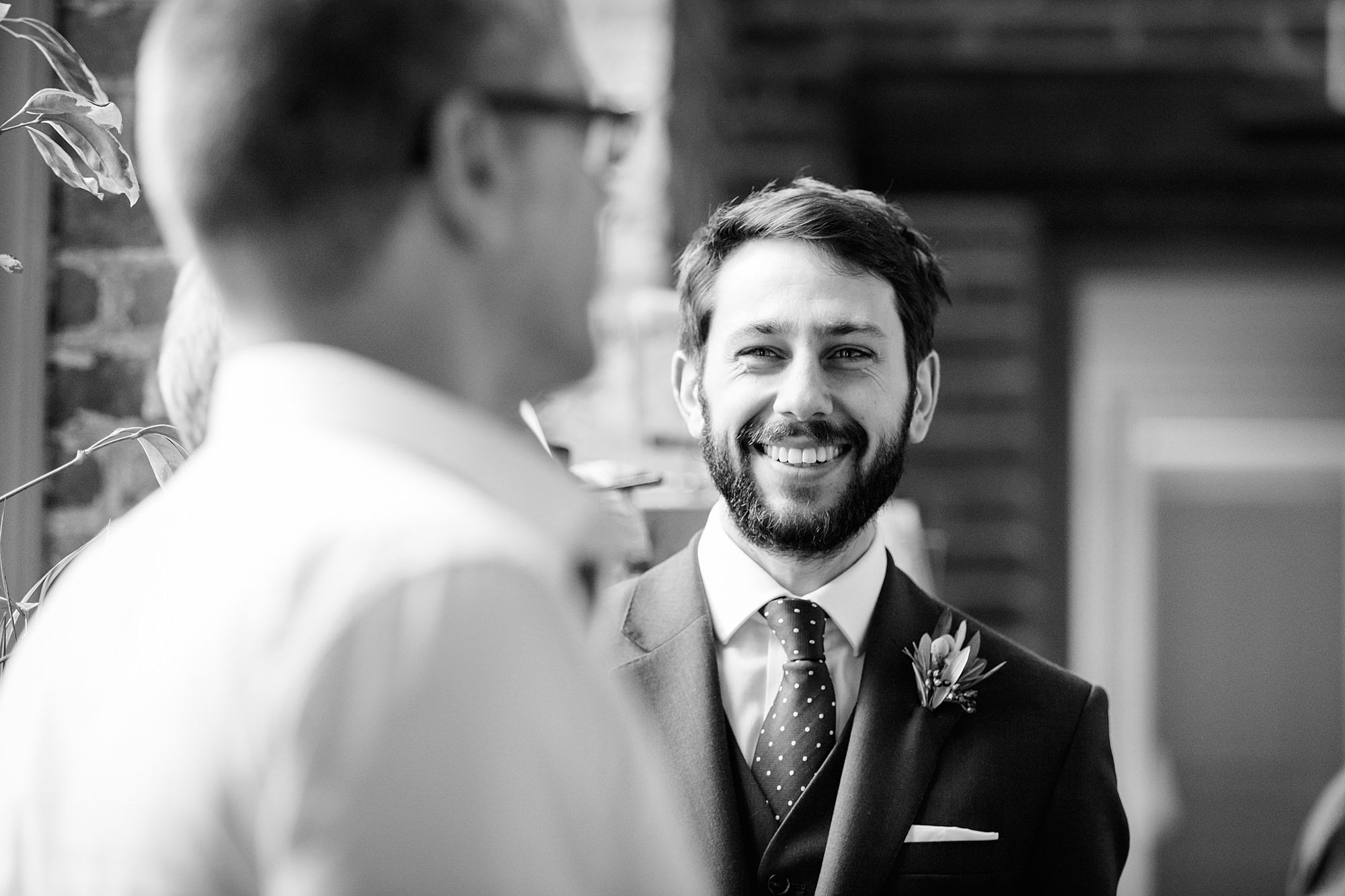 shaw house wedding groom laughs with gues