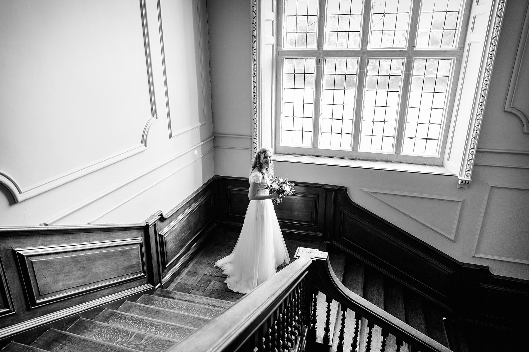 shaw house wedding bride walks down stairs