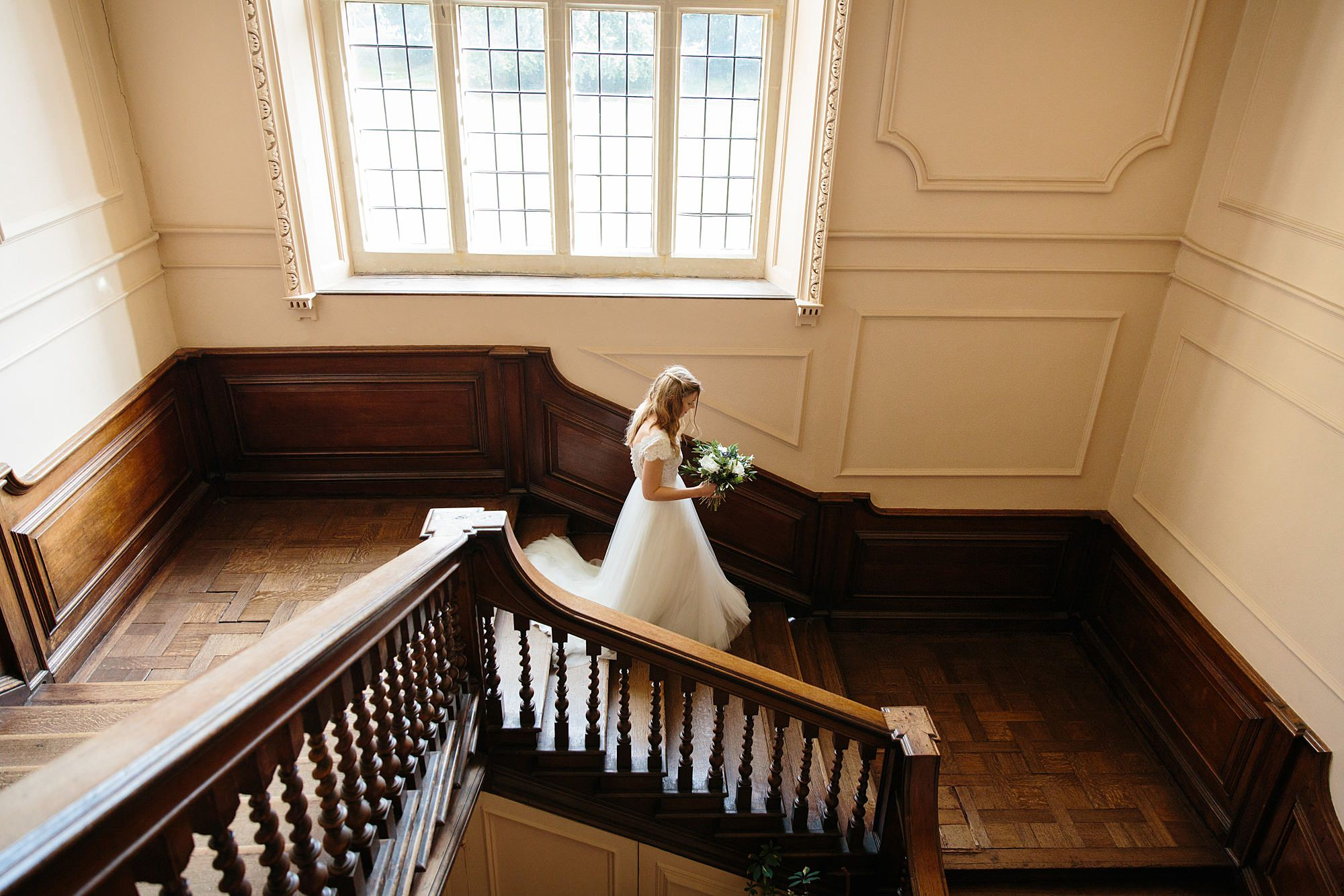 shaw house wedding bride walking down staircase