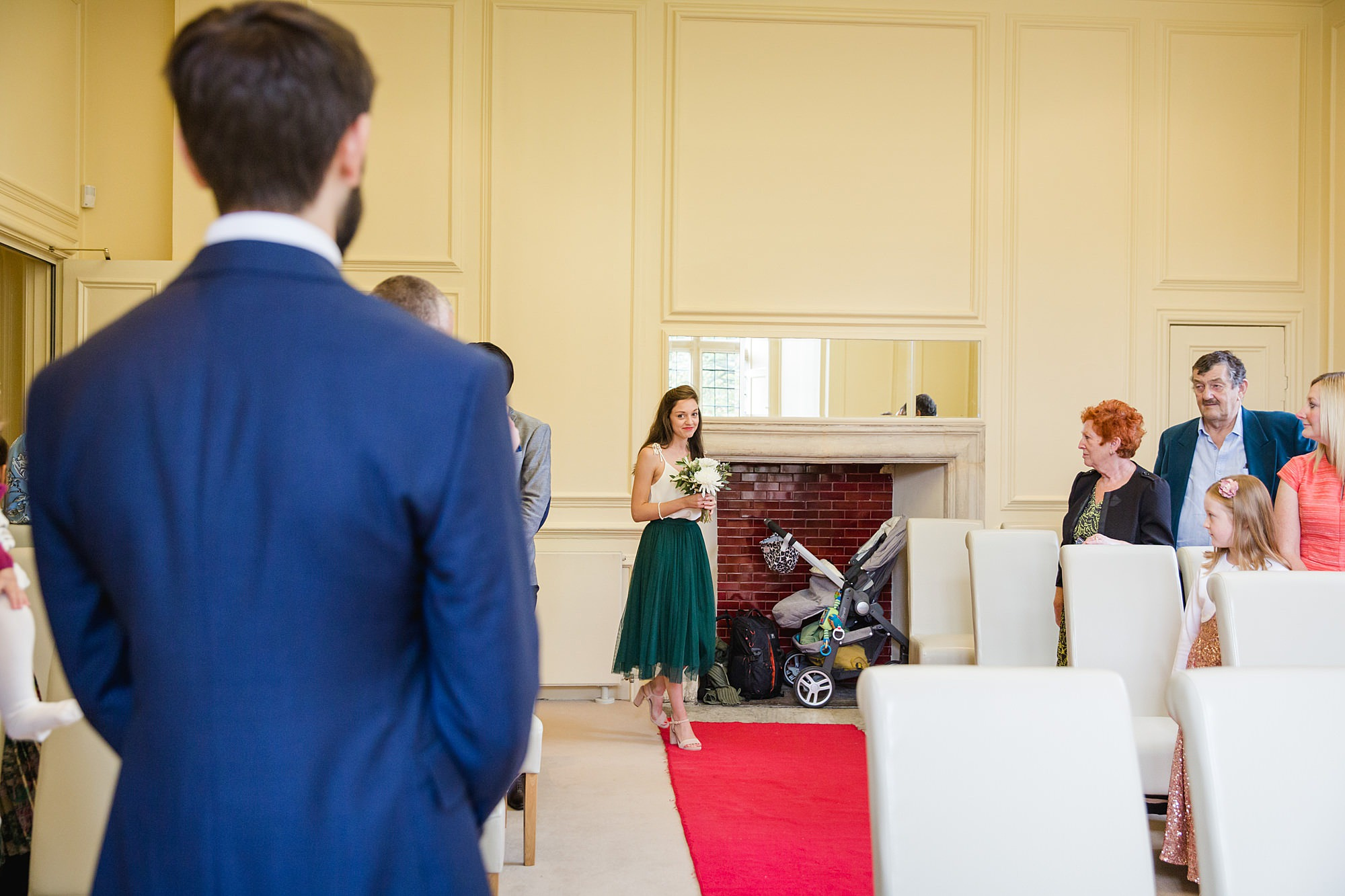 shaw house wedding bridesmaid walks down aisle