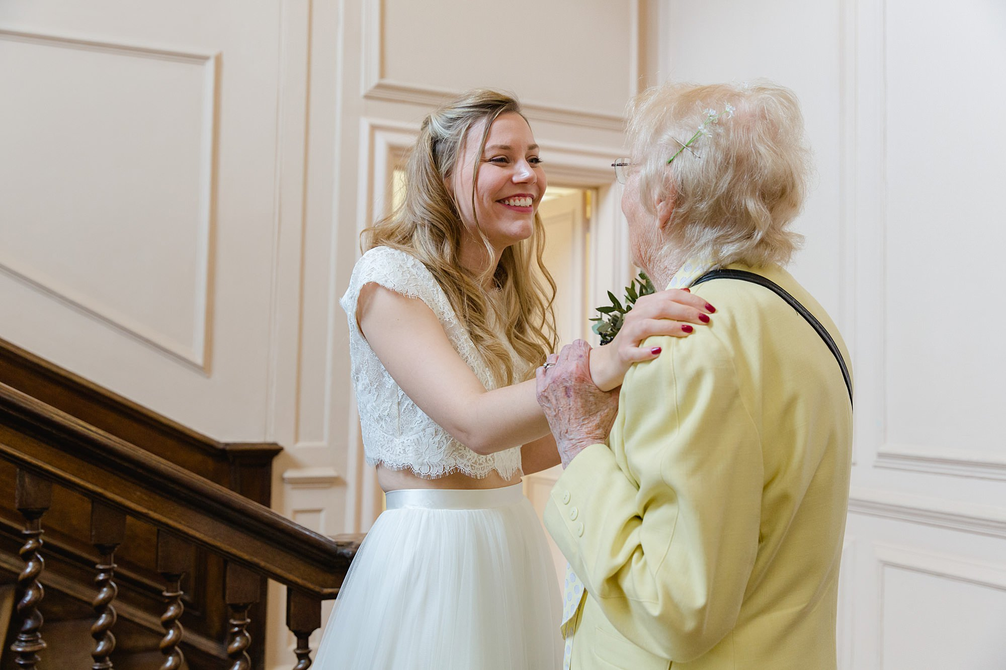 shaw house wedding bride greets her grandmotherportrait of bride greeting her grandmother after shaw house wedding ceremony