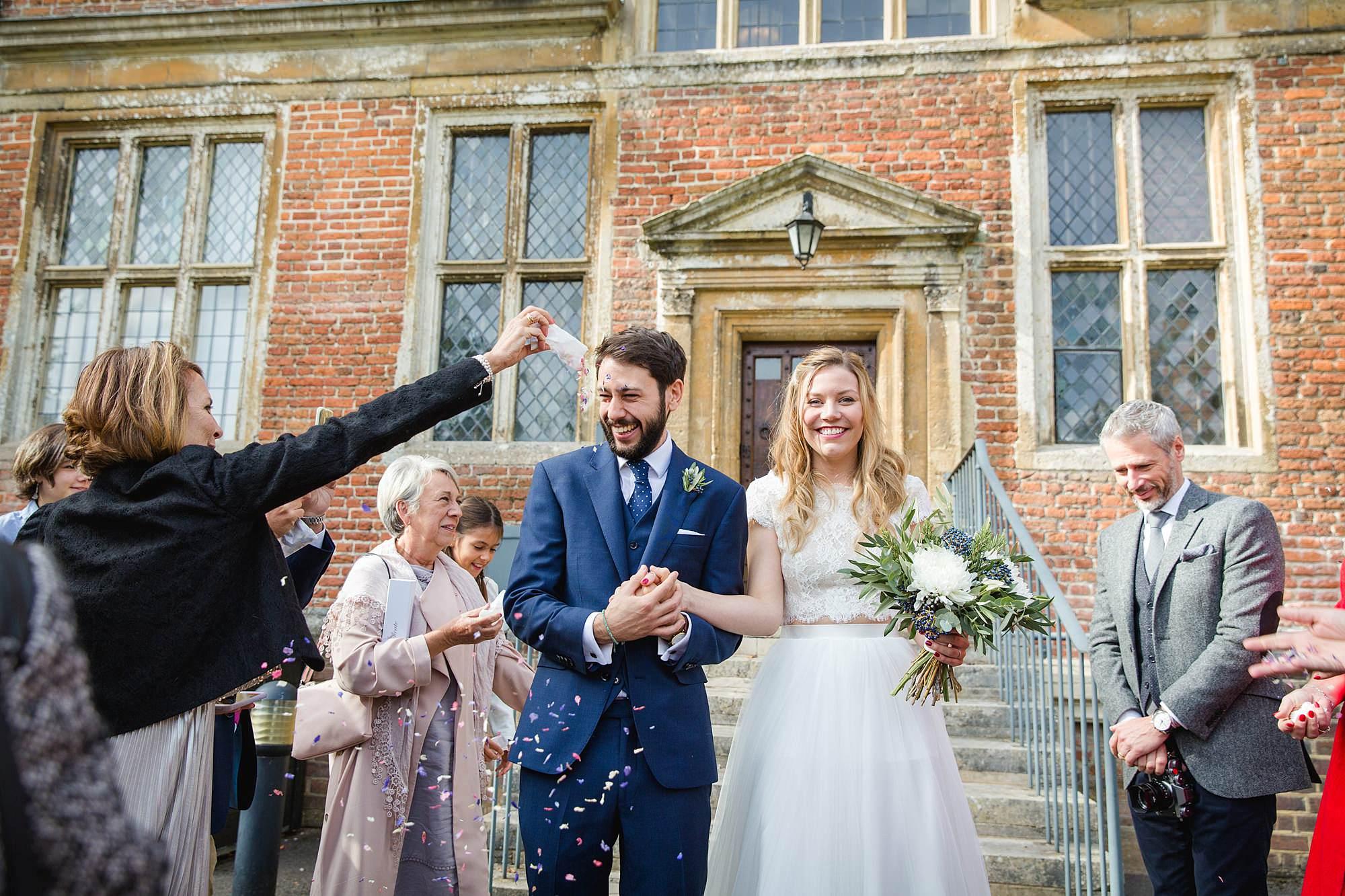 shaw house wedding bride and groom walk through confetti
