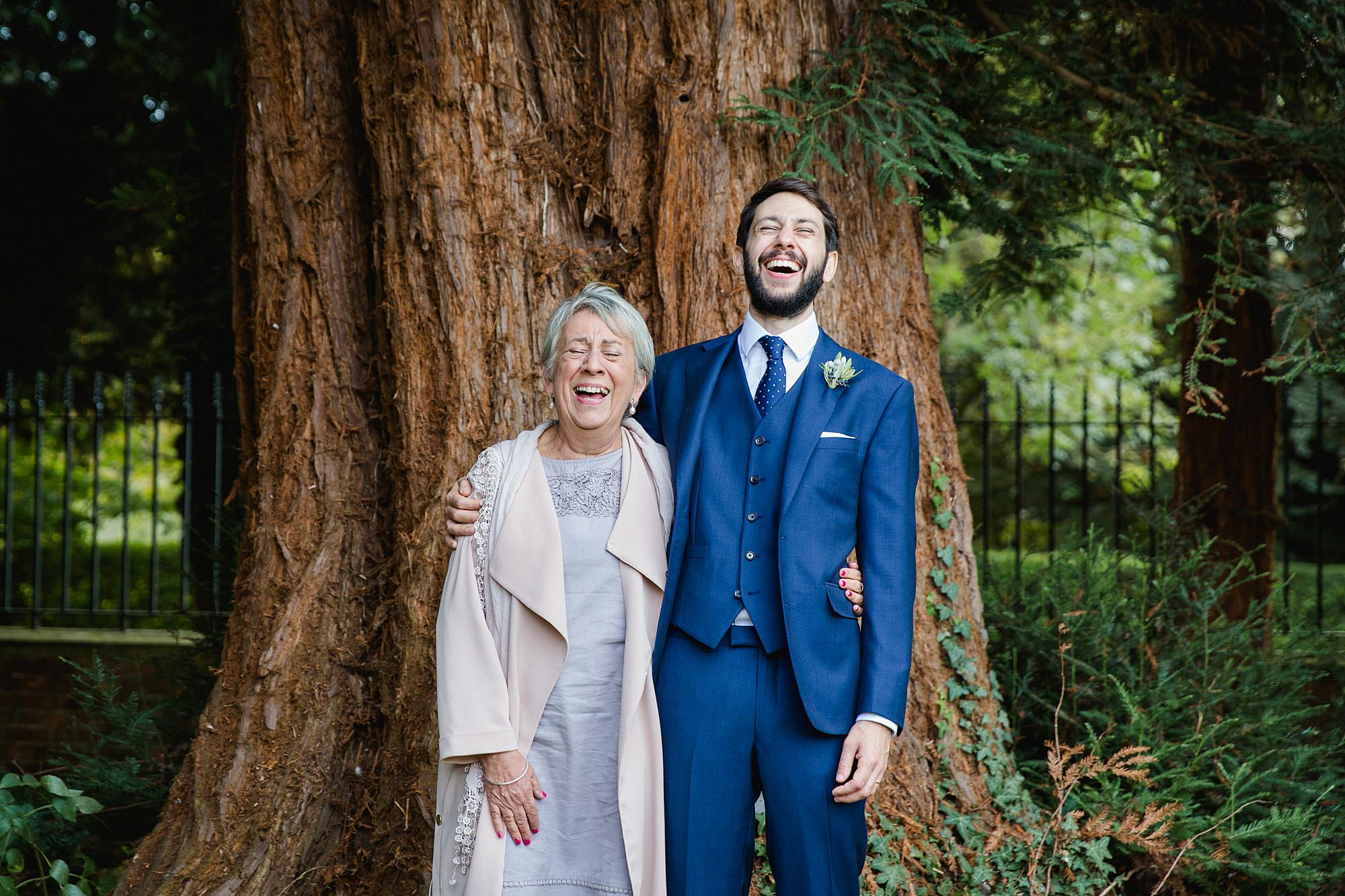 shaw house wedding groom laughs with his mother