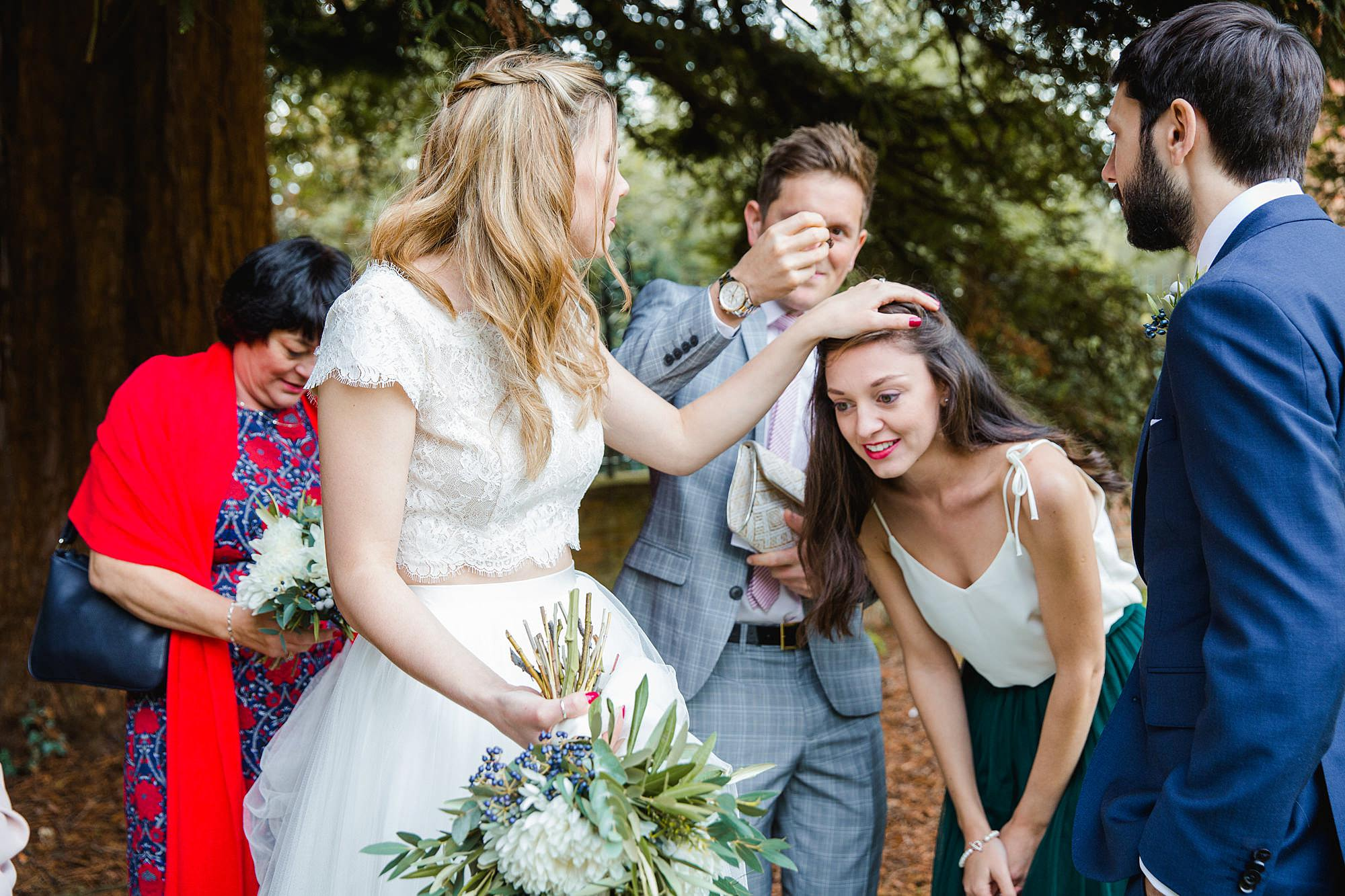 shaw house wedding bride getting confetti out of bridesmaid's hair