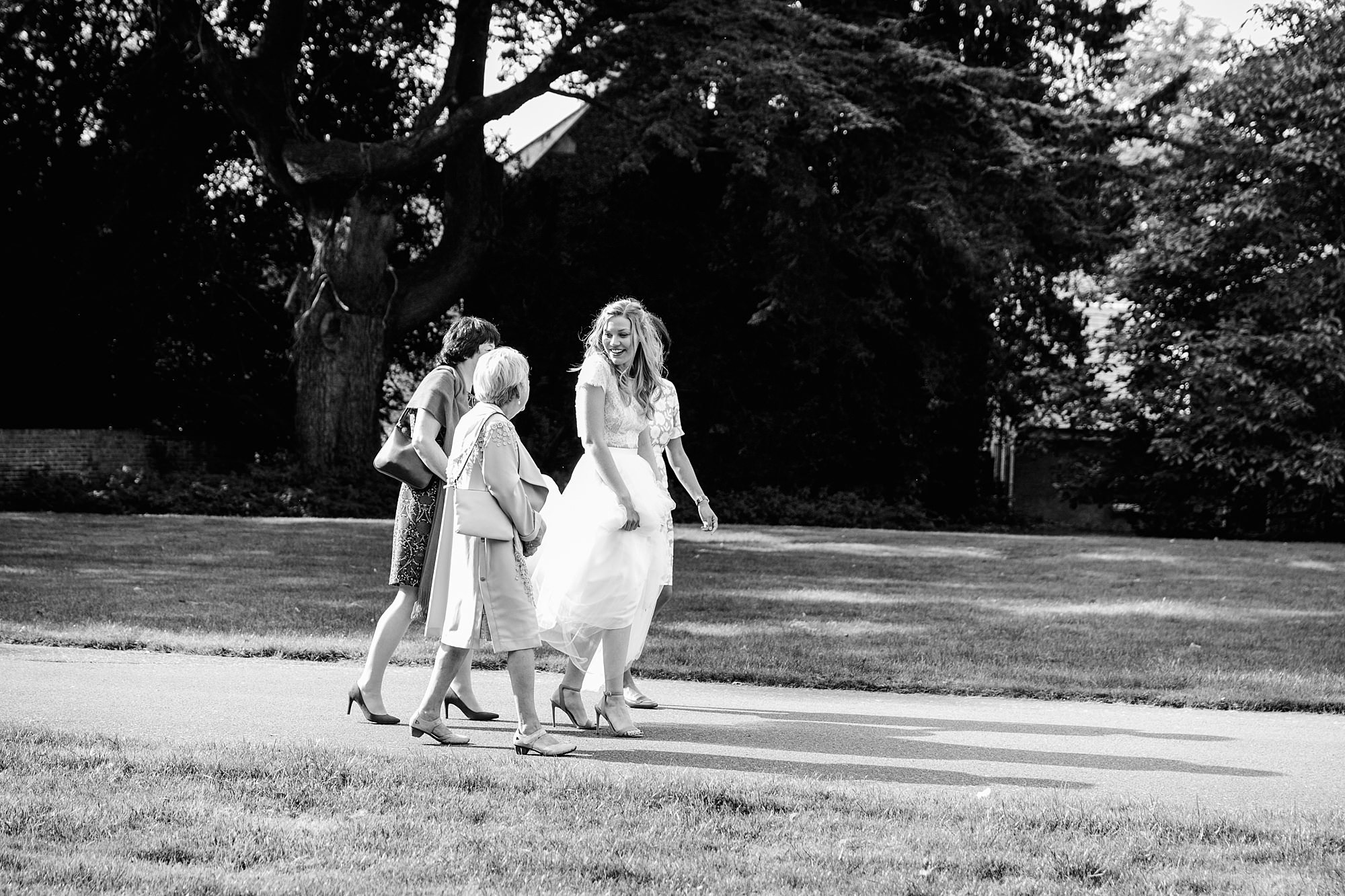 shaw house wedding bride walks and talks with guest