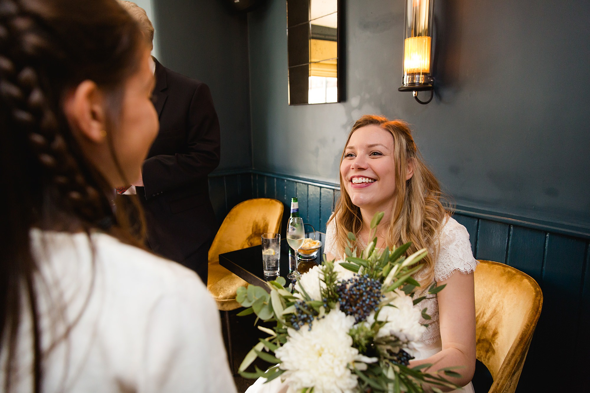 shaw house wedding bride chats with guests