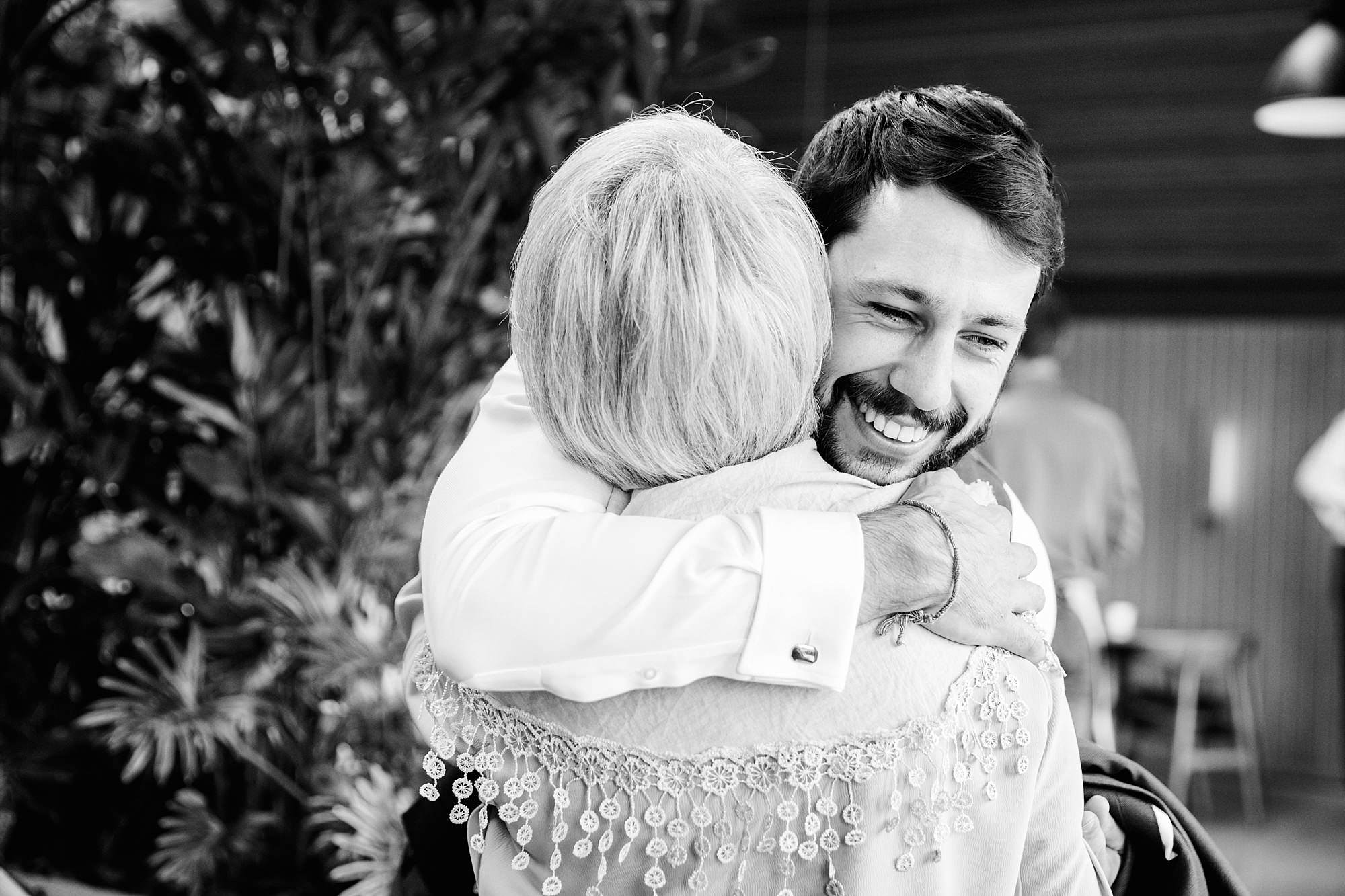 shaw house wedding groom hugs mum